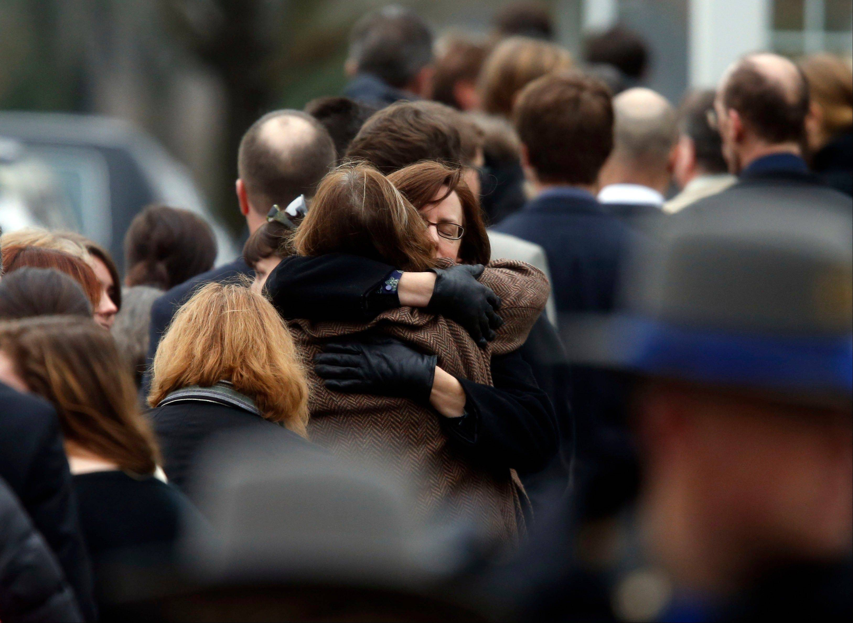 Mourners arrive at a funeral service for 6-year-old Noah Pozner on Monday in Fairfield, Conn. Pozner was killed when a gunman walked into Sandy Hook Elementary School in Newtown Friday and opened fire, killing 26 people, including 20 children.