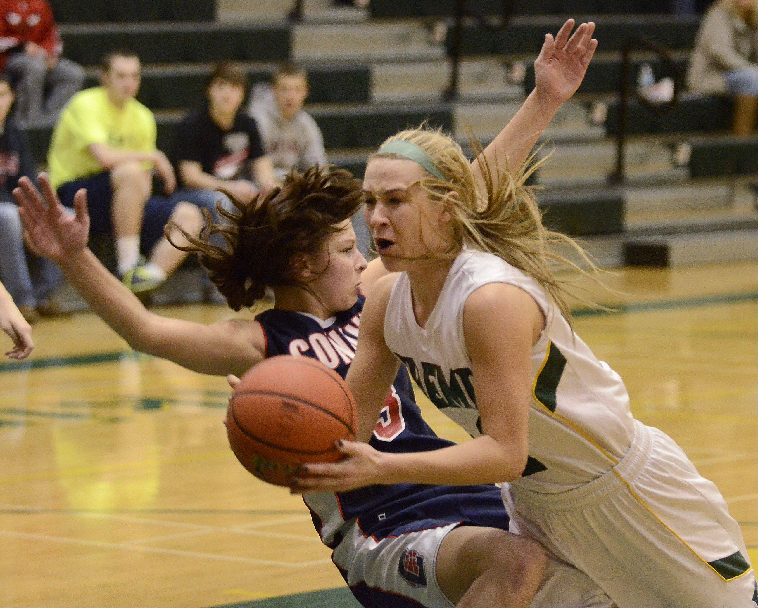 Fremd's Ashley McConnell, 21, draws a foul from Conant's Dee Dee Durr during Thursday's basketball game in Palatine.