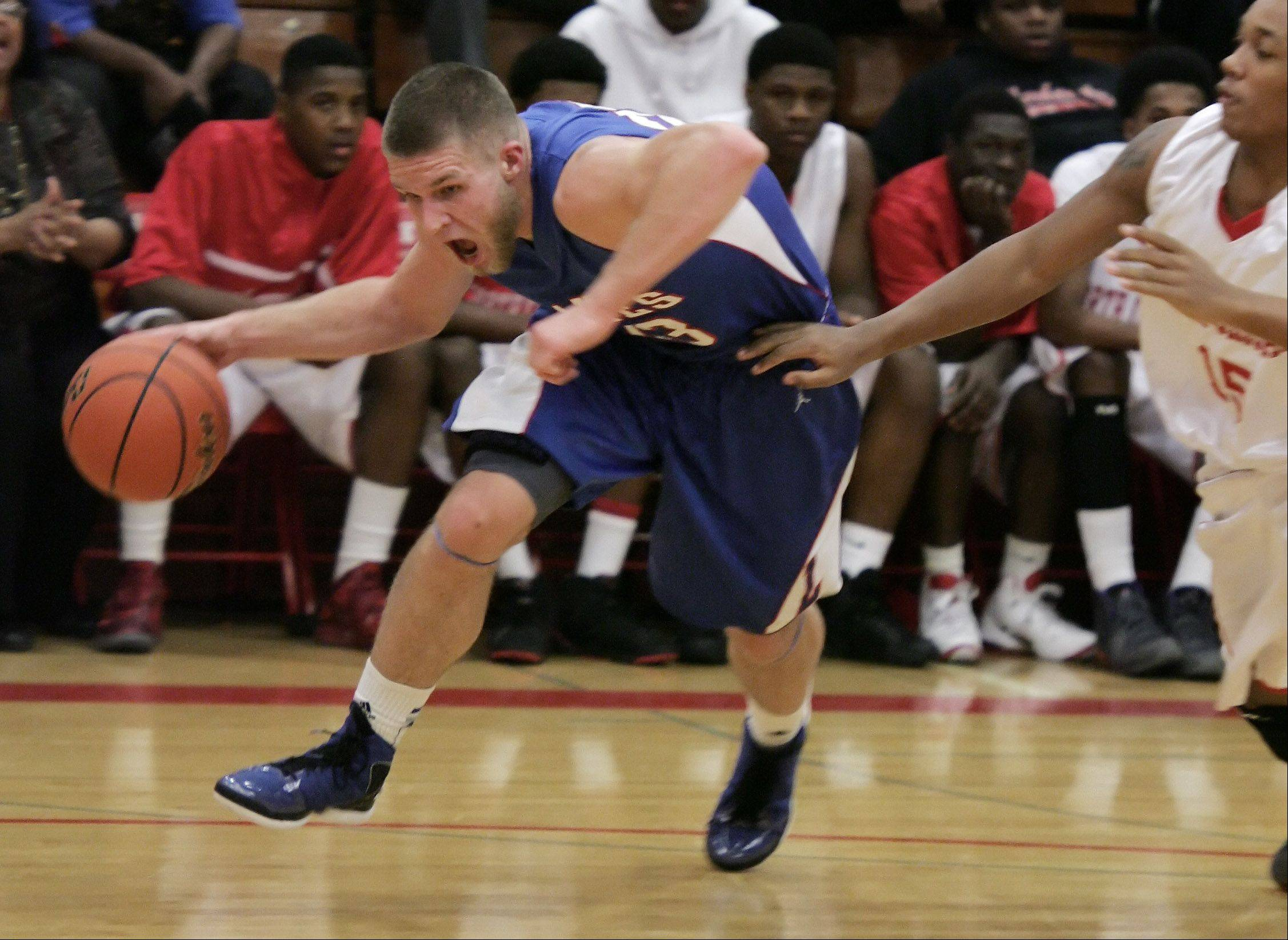 Lakes' Jake Kohler drives to the hoop during Thursday's game in North Chicago.