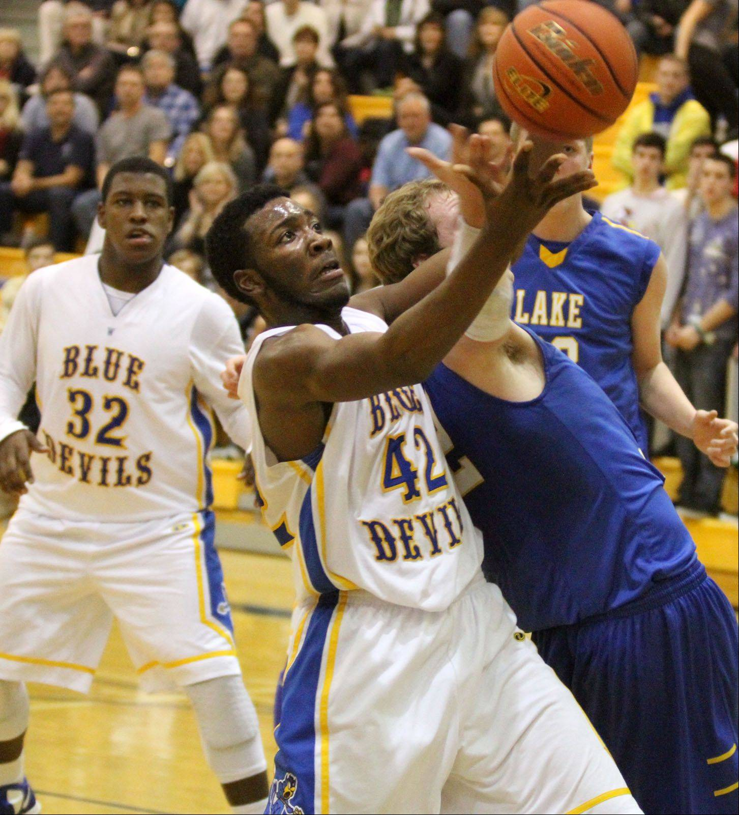 Warren's Dre Von Hill pulls in a rebound against Lake Forest in Gurnee on Friday.