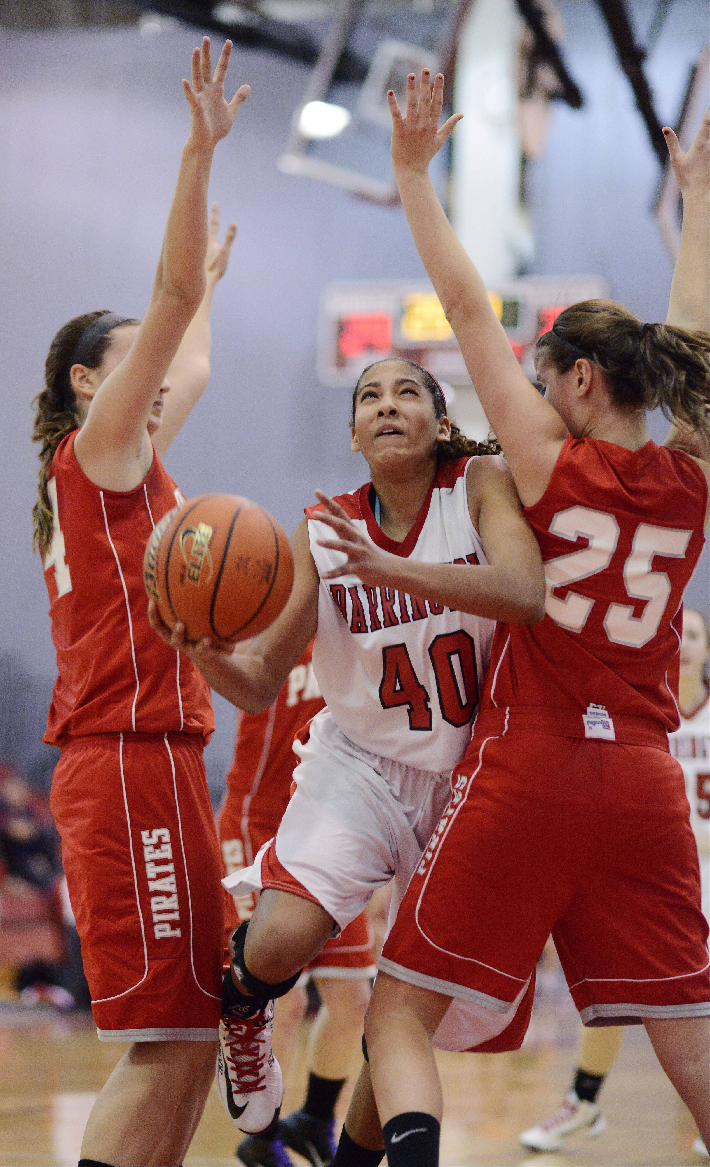 Barrington's Bryanna Hopkins, middle, squeezes between Palatine's Monica Macini, left, and Erin Mayer during Tuesday's game.