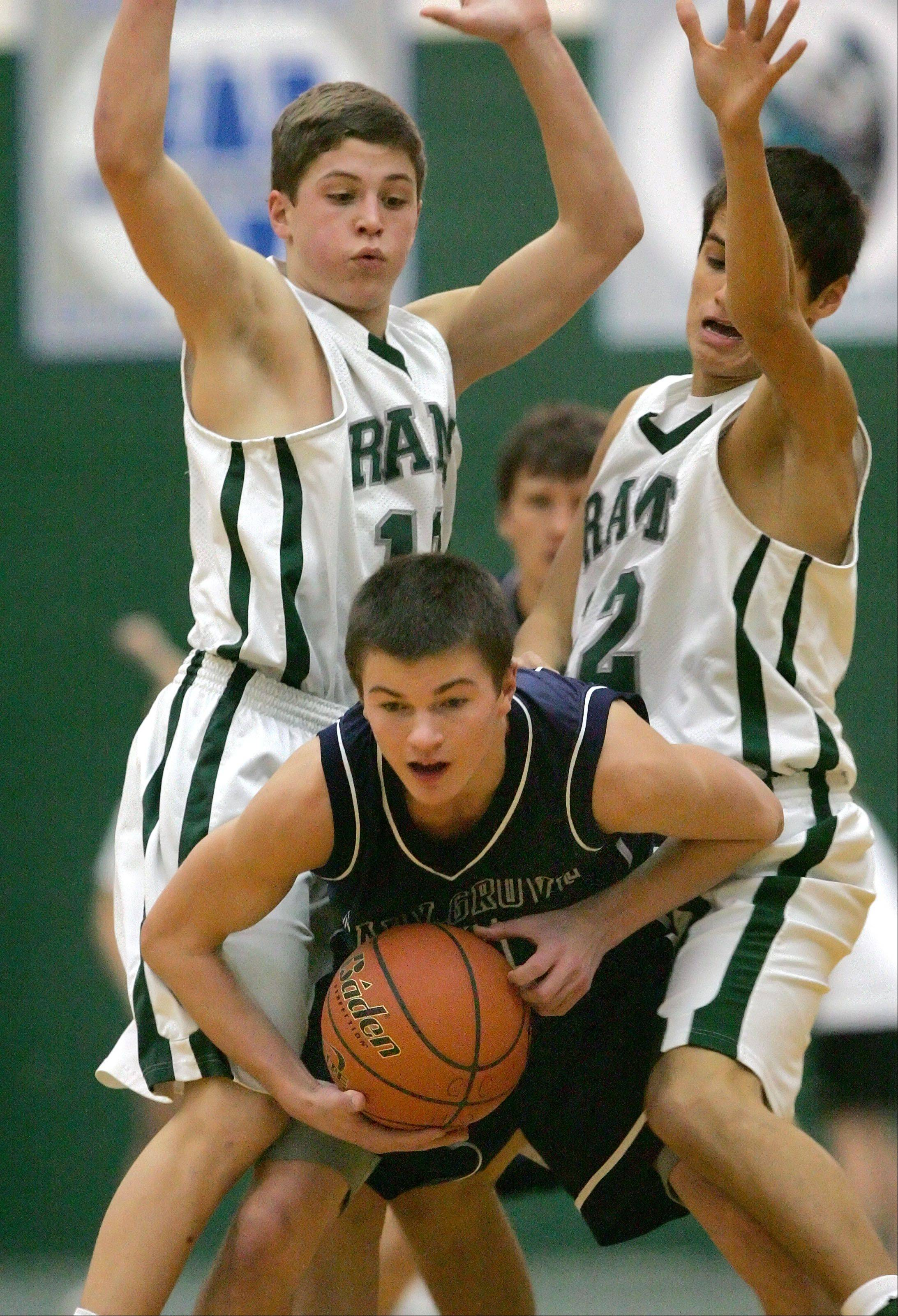 Grayslake Central's Joey Mudd, left, and Kevin Orozco double team Cary-Grove's Ian May during their game Tuesday night in Grayslake.
