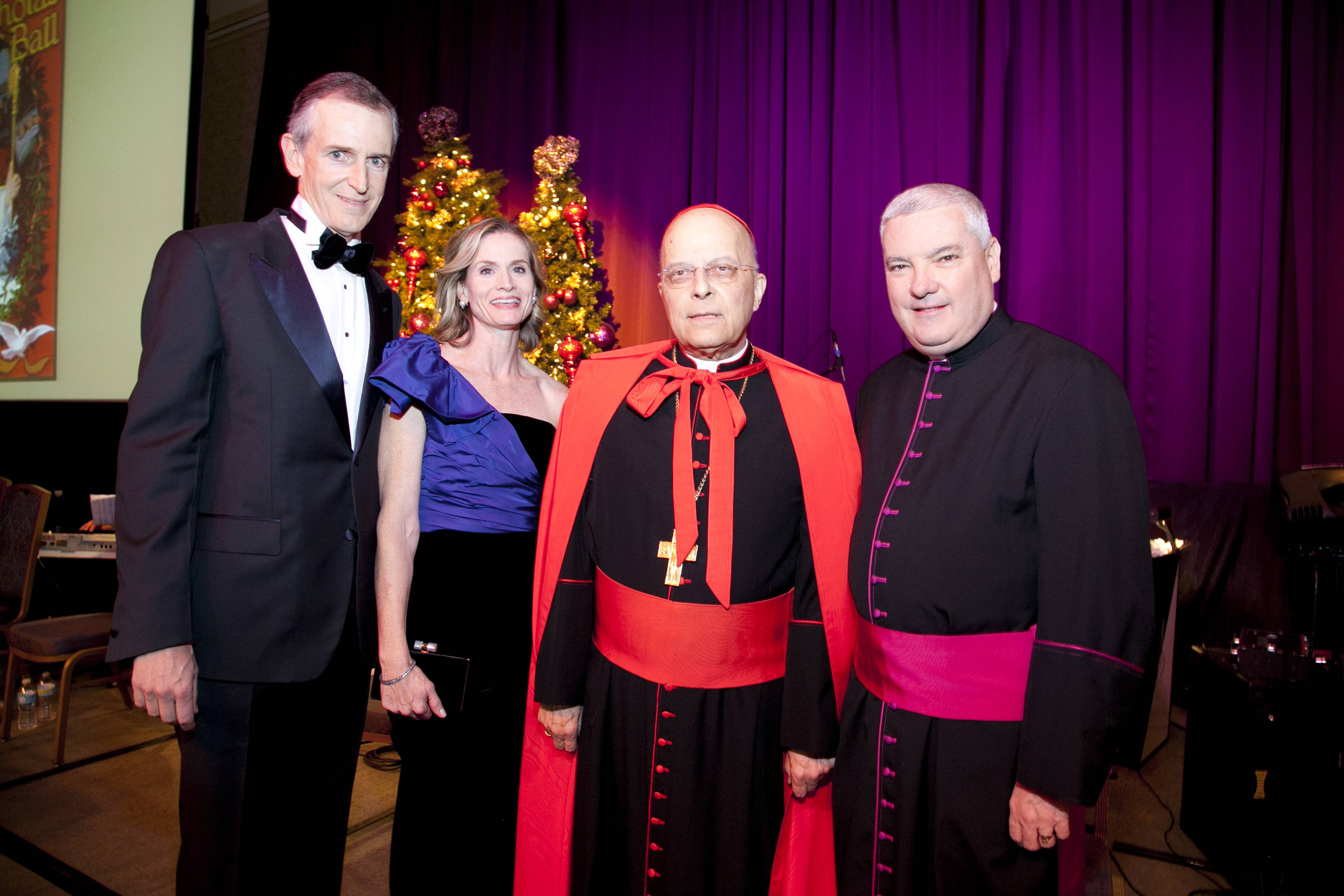 Jim and Molly Perry, Chaircouple of the 23rd annual Spirit of Saint Nicholas Ball; Francis Cardinal George O.M.I.; Msgr. Michael M. Boland, president and CEO of Catholic Charities all enjoy the evening at the 2012 Spirit of Saint Nicholas Ball on Friday, Dec. 7 at the Hilton Chicago.
