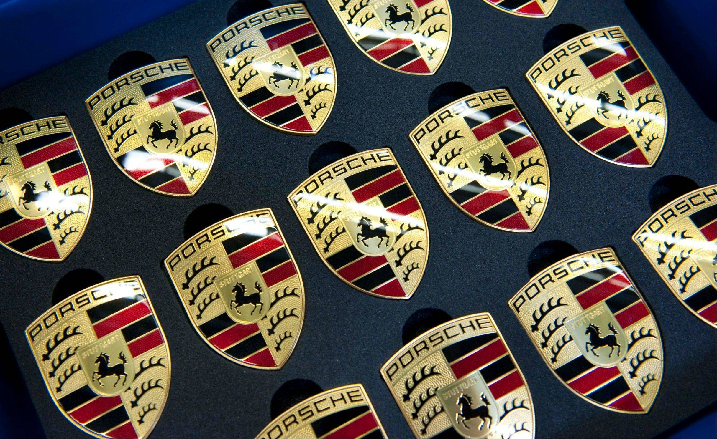 German prosecutors have charged two former Porsche executives with market manipulation in connection with the sports car company�s failed takeover of Volkwagen AG.