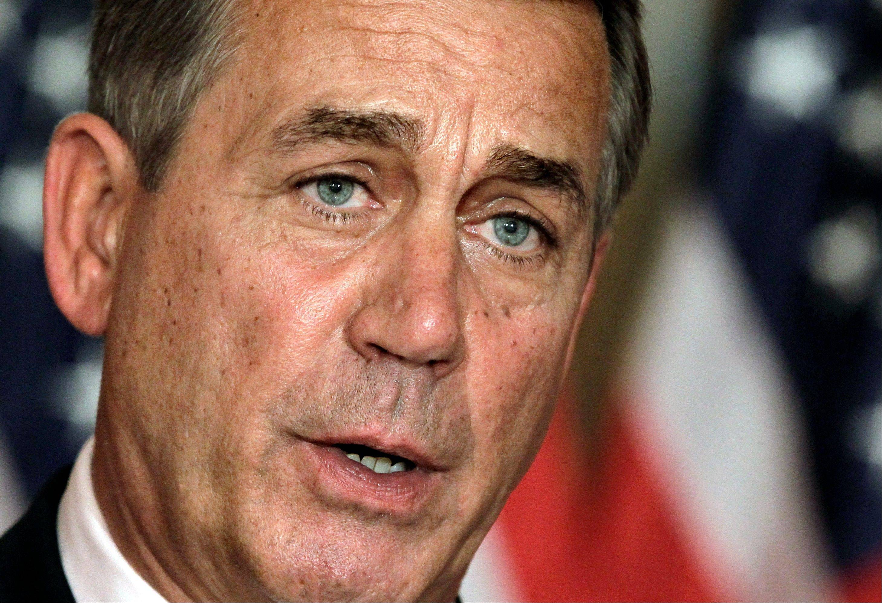 Speaker John Boehner scrambled Wednesday to rally House Republicans behind a plan to extend tax cuts on income up to $1 million, defying President Barack Obama�s veto threat and setting up a showdown that could send Washington over the year-end �fiscal cliff.�