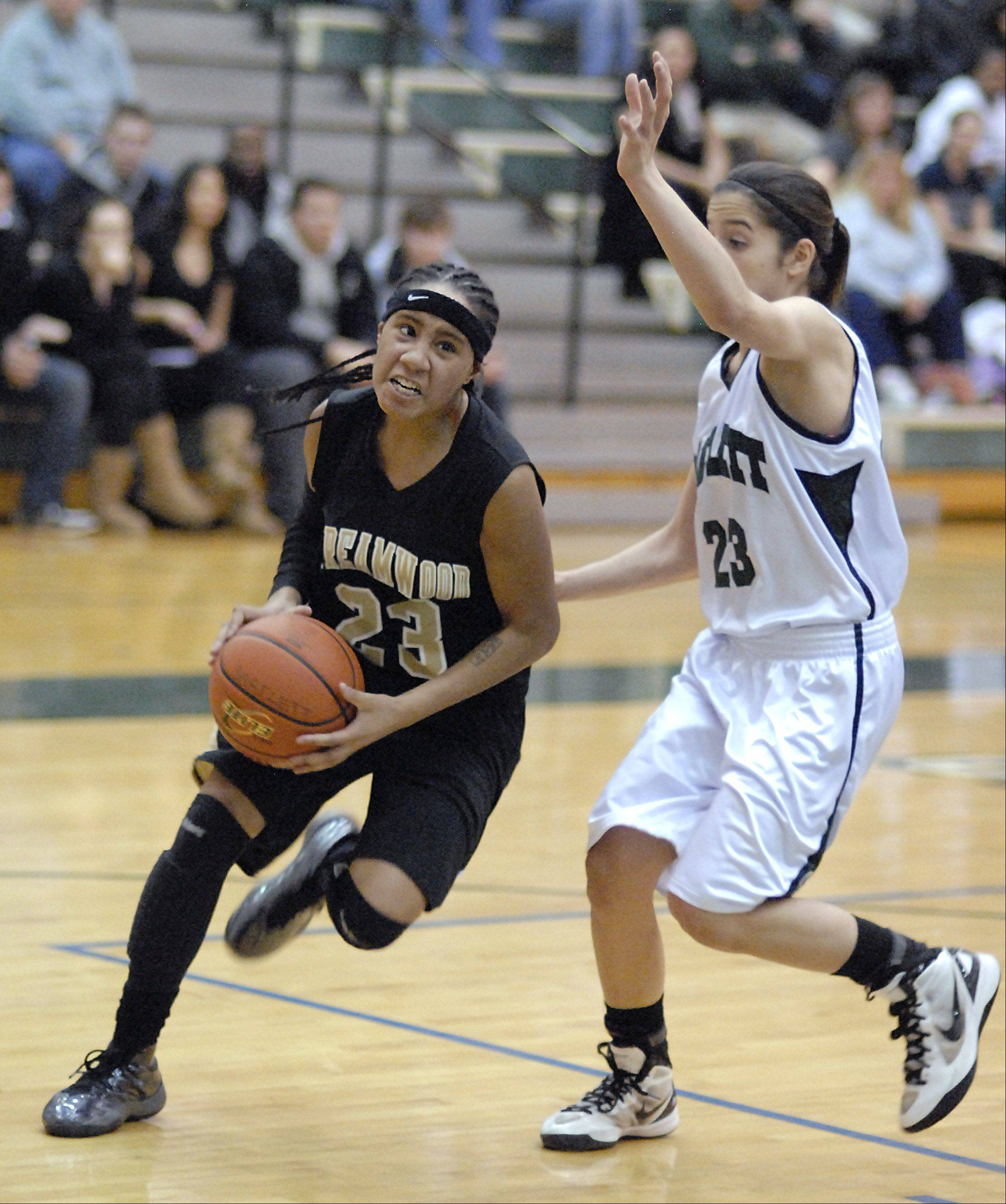 Streamwood�s Deja Moore approaches the basket with Bartlett�s Ally Giampapa defending in the fourth quarter on Wednesday at Bartlett.
