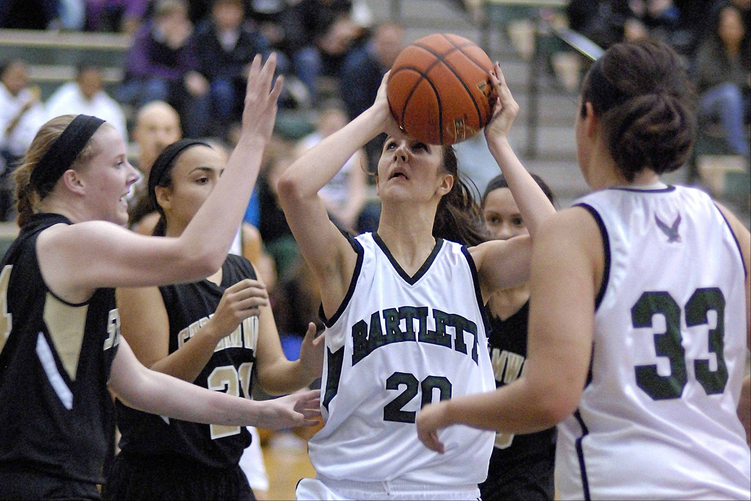Streamwood�s Hannah McGlone attempts to block a shot by Bartlett�s Elizabeth Arco in the second quarter.