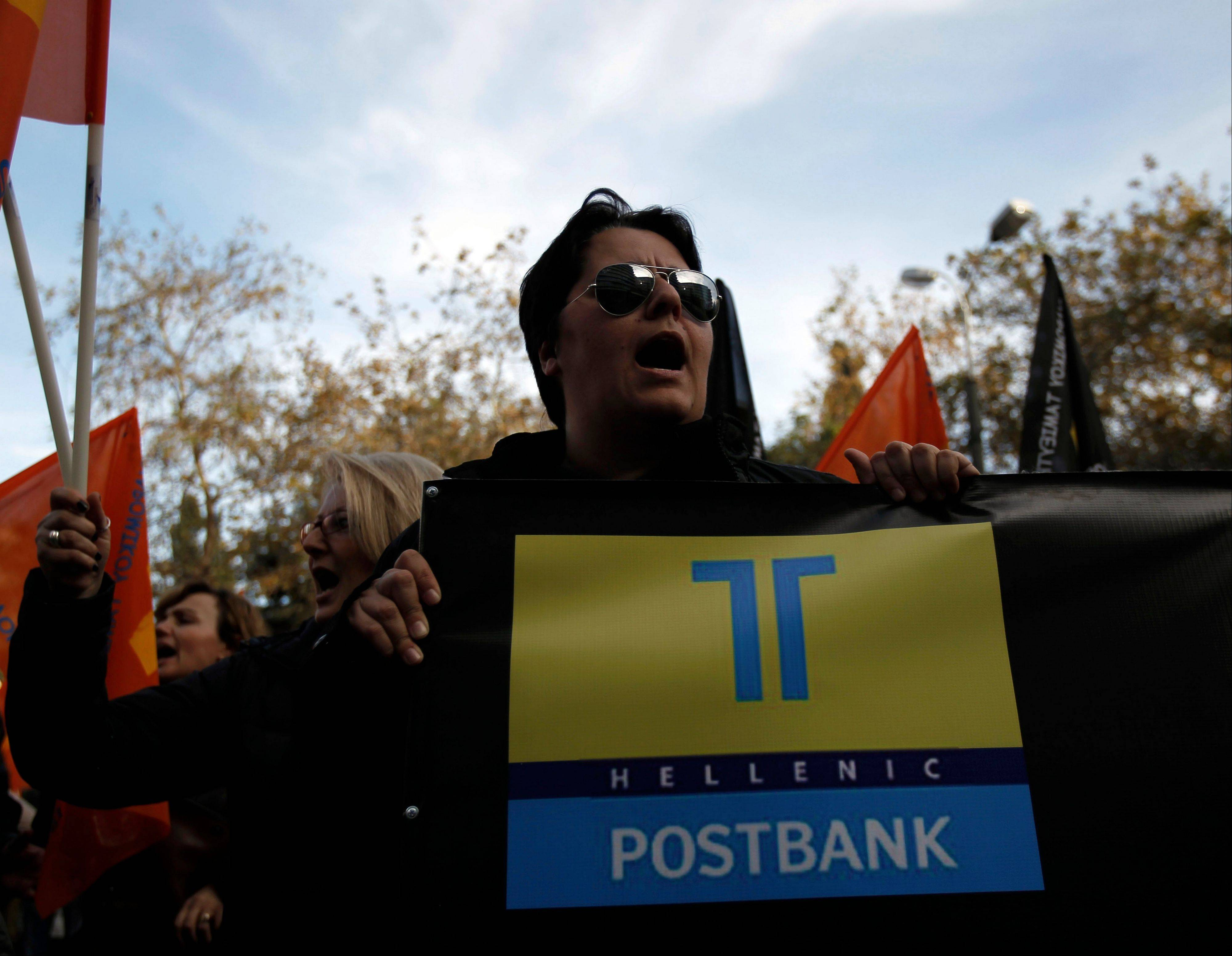 Civil servants in Greece are on a 24-hour strike against new austerity measures that will see more pay cuts next year as well as a rare round of job cuts.
