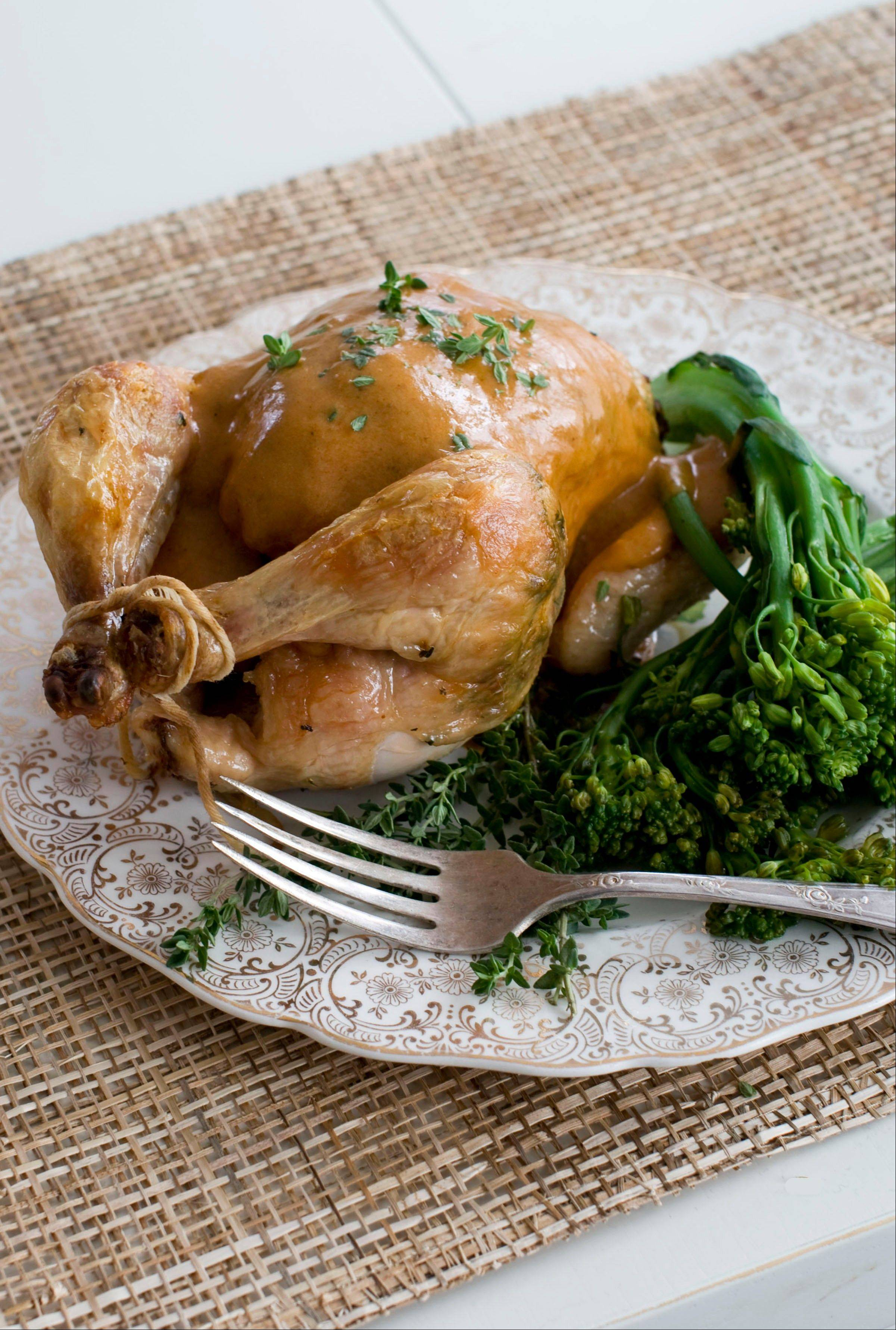 Herb roasted Cornish game hen with creamy mustard sauce makes a big impact as a holiday dinner.