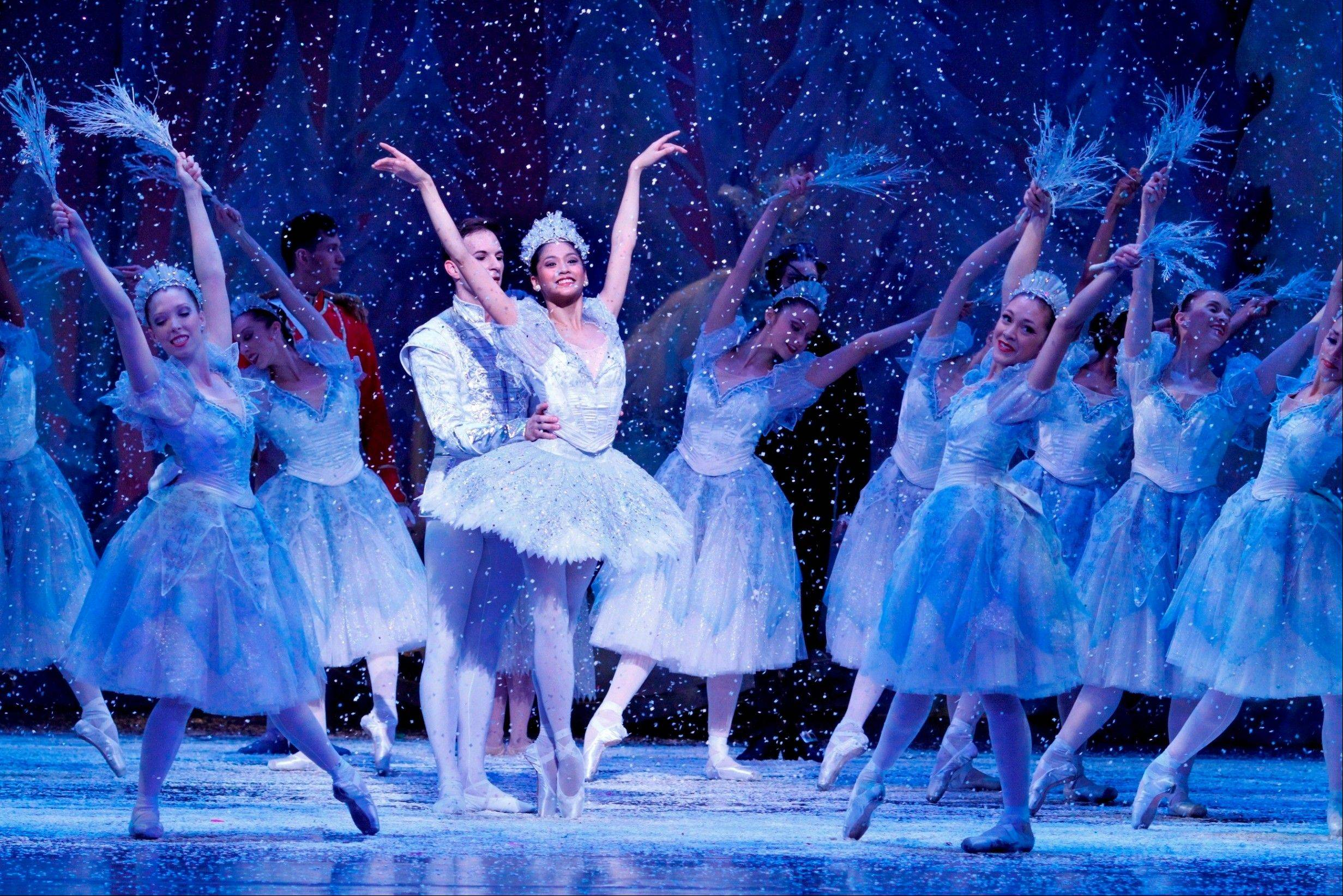 Rory Hohenstein and Christine Rocas dance as the Snow King and Queen in the Joffrey Ballet?s ?The Nutcracker? at the Auditorium Theatre of Roosevelt University in Chicago.