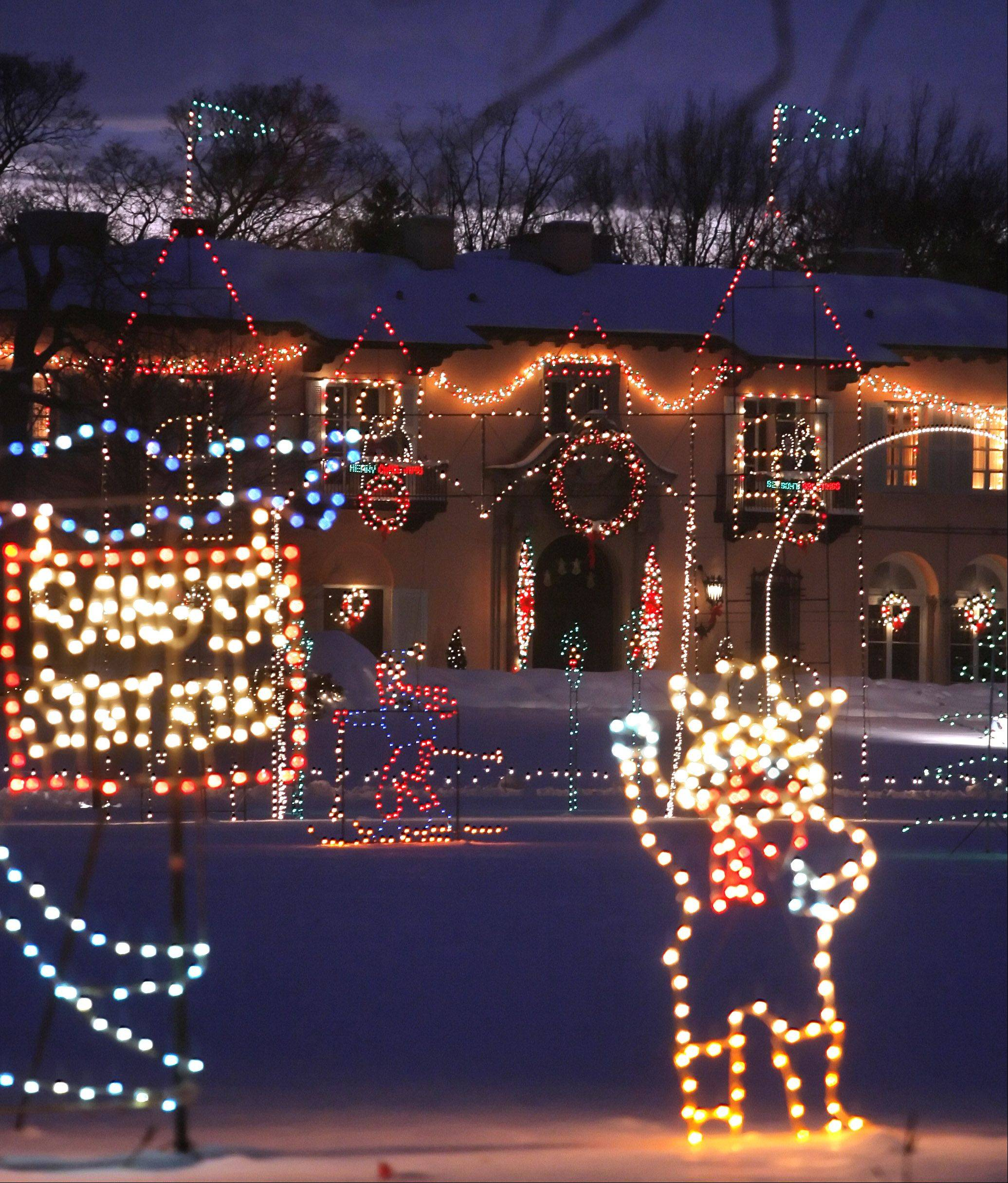 "Holiday lights twinkle in front of the Cuneo Mansion in Vernon Hills during the annual Cuneo Museum and Garden's ""Winter Wonderland"" holiday light show."