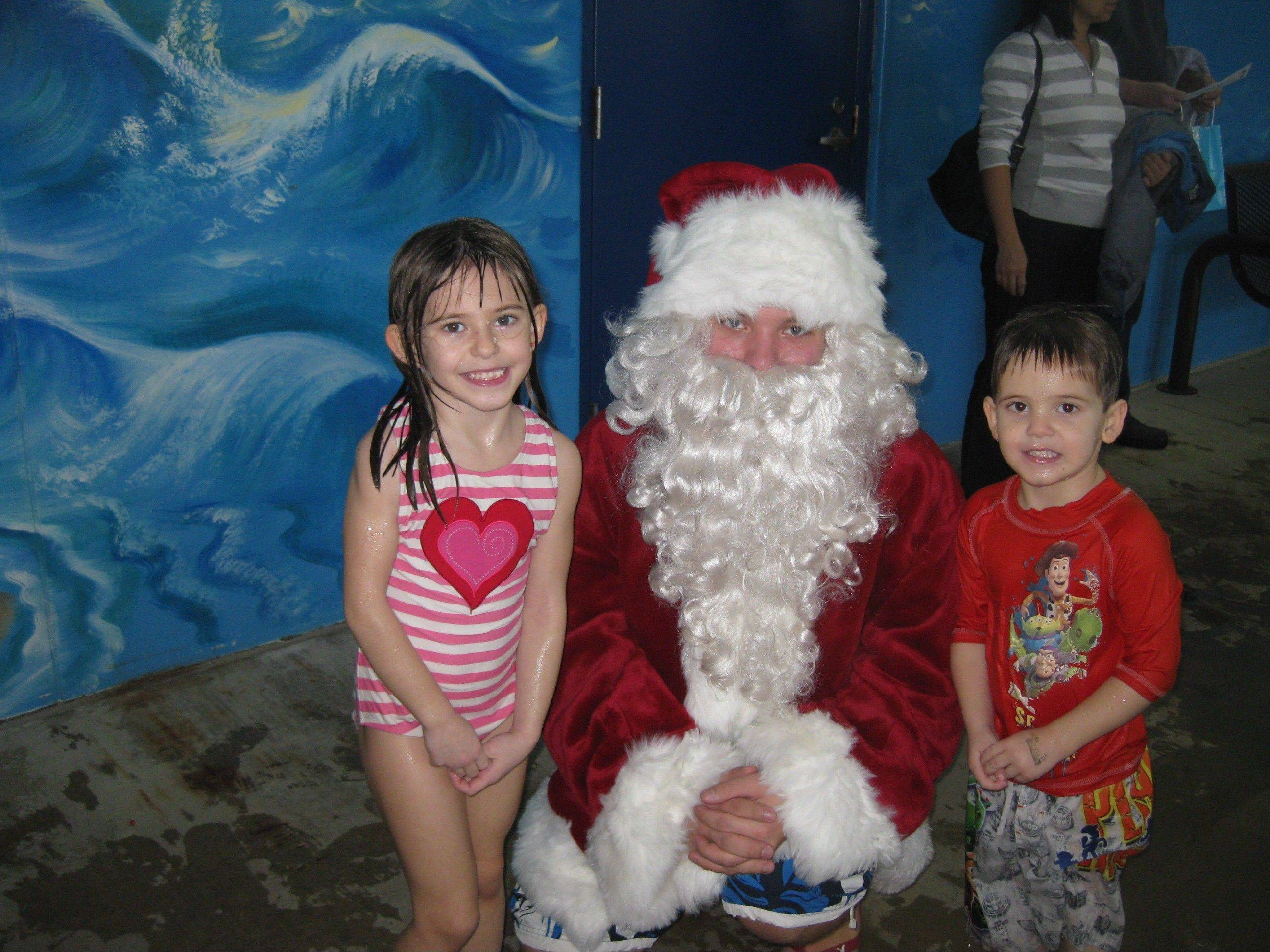"Santa Claus will be in the pool and on the pool's deck to meet with youngsters at the ""Swim With Santa"" event at the Elk Grove Pavilion Aquatic Center in Elk Grove Village."