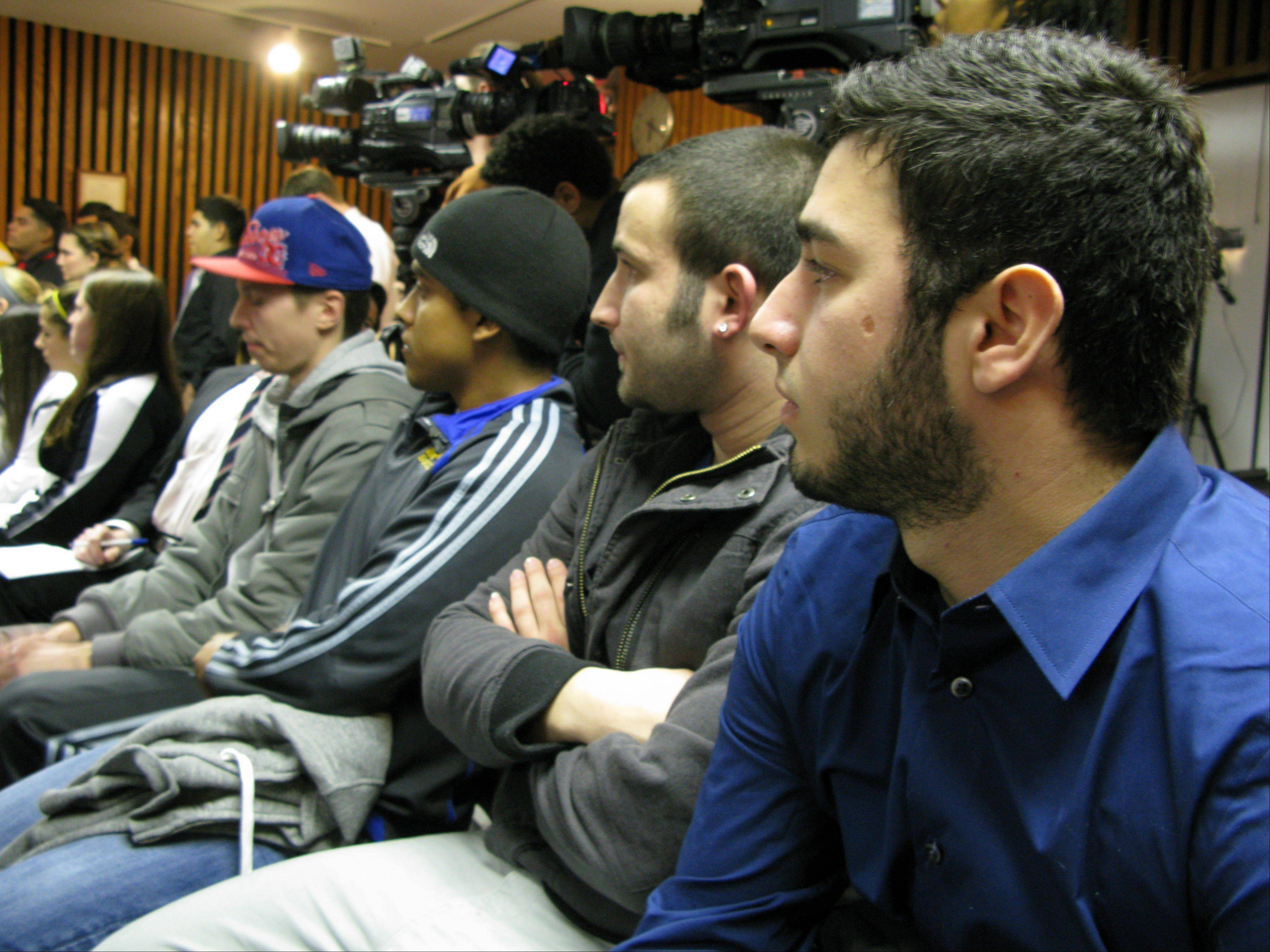 Dozens of former and current Maine West High School soccer players, including Joey Ruffolo, at right, voiced their support Wednesday night for head boys varsity soccer coach Michael Divincenzo, who was fired from his job after a hazing scandal at the high school.