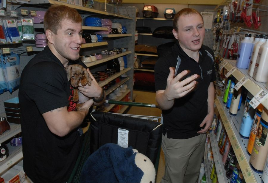 Matt Plackowski of Naperville works with Petland Sales Manager Jacob Friedl on picking out dog shampoo.