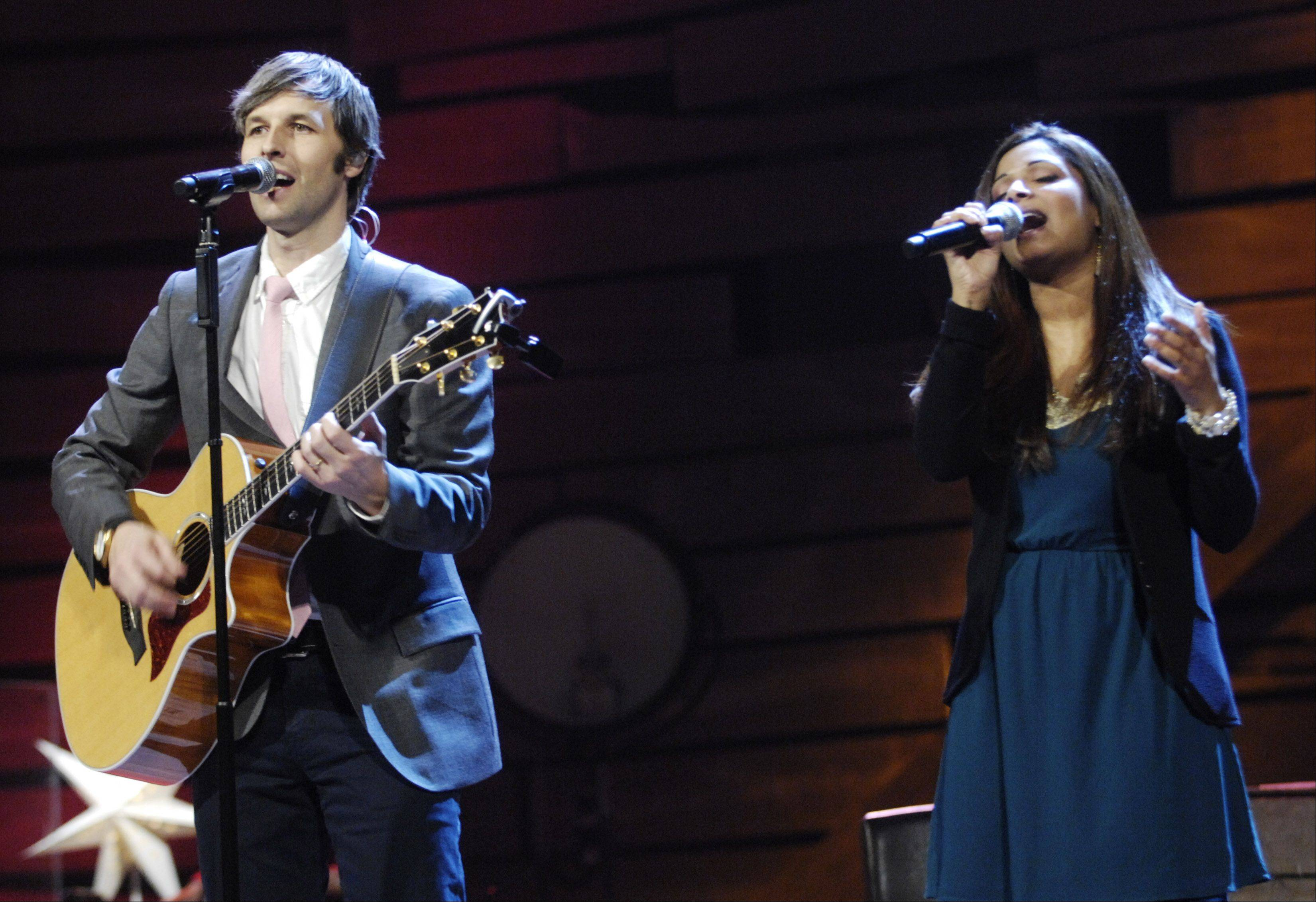 Matt Lundgren, left, and Alisha Thomas sing during dress rehearsal Tuesday for Willow Creek Community Church's Christmas services in South Barrington.