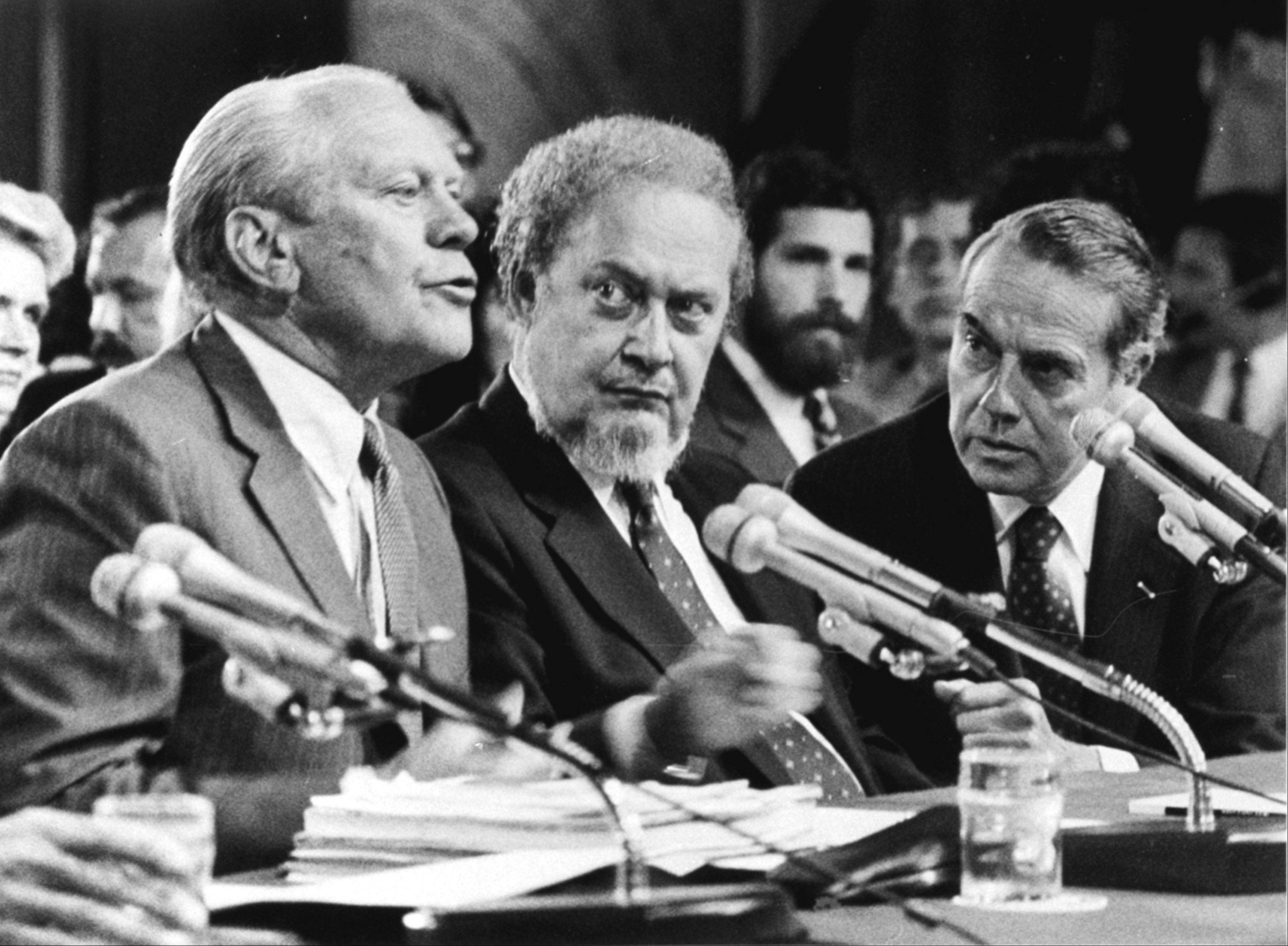 "FILE -- In this Sept. 15, 1987 file photo, Former President Gerald Ford, left, introduces Supreme Court Associate Justice nominee Robert Bork, during Senate Judiciary Committee confirmation hearings in 1987. Ford praised Bork as being ""uniquely qualified"" for the post."