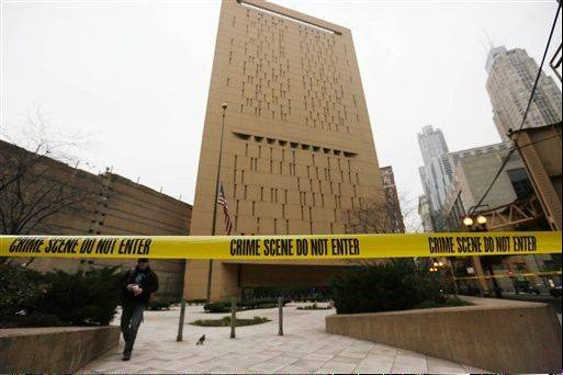 Two convicted bank robbers used a knotted rope or bed sheets to escape from the Metropolitan Correctional Center window high above downtown Chicago early Tuesday, a week after one of them made a courtroom vow of retribution, to federal judge. The escape occurred sometime between 5 a.m. and 8:45 a.m. when the inmates were discovered missing, Chicago Police Sgt. Mark Lazarro said. Hours later, what appeared to be a rope, knotted at six-foot intervals, could be seen dangling into an alley from a window of the Metropolitan Correctional Center approximately 20 stories above the ground.