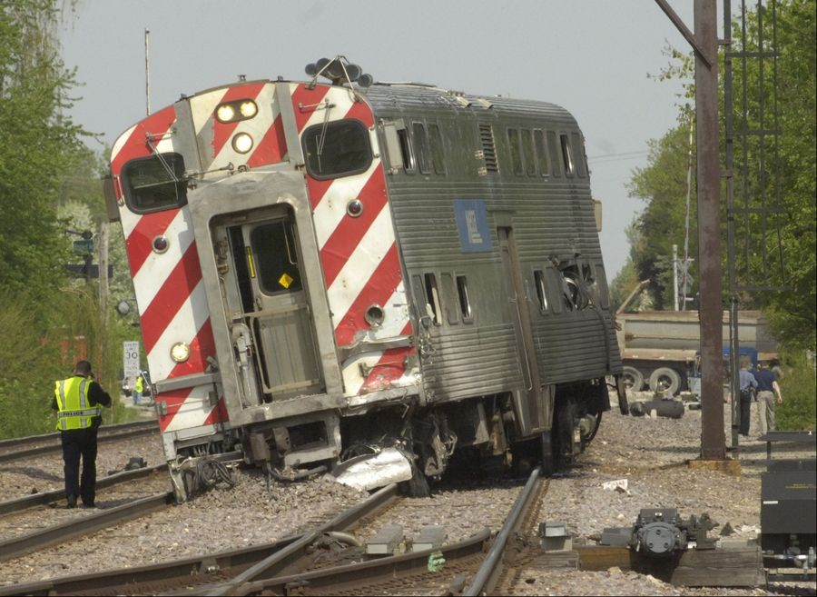 A Metra train car derailed after a collision with a loaded dump truck whose driver ignored a lowered gate at a Mount Prospect crossing in May 2011.