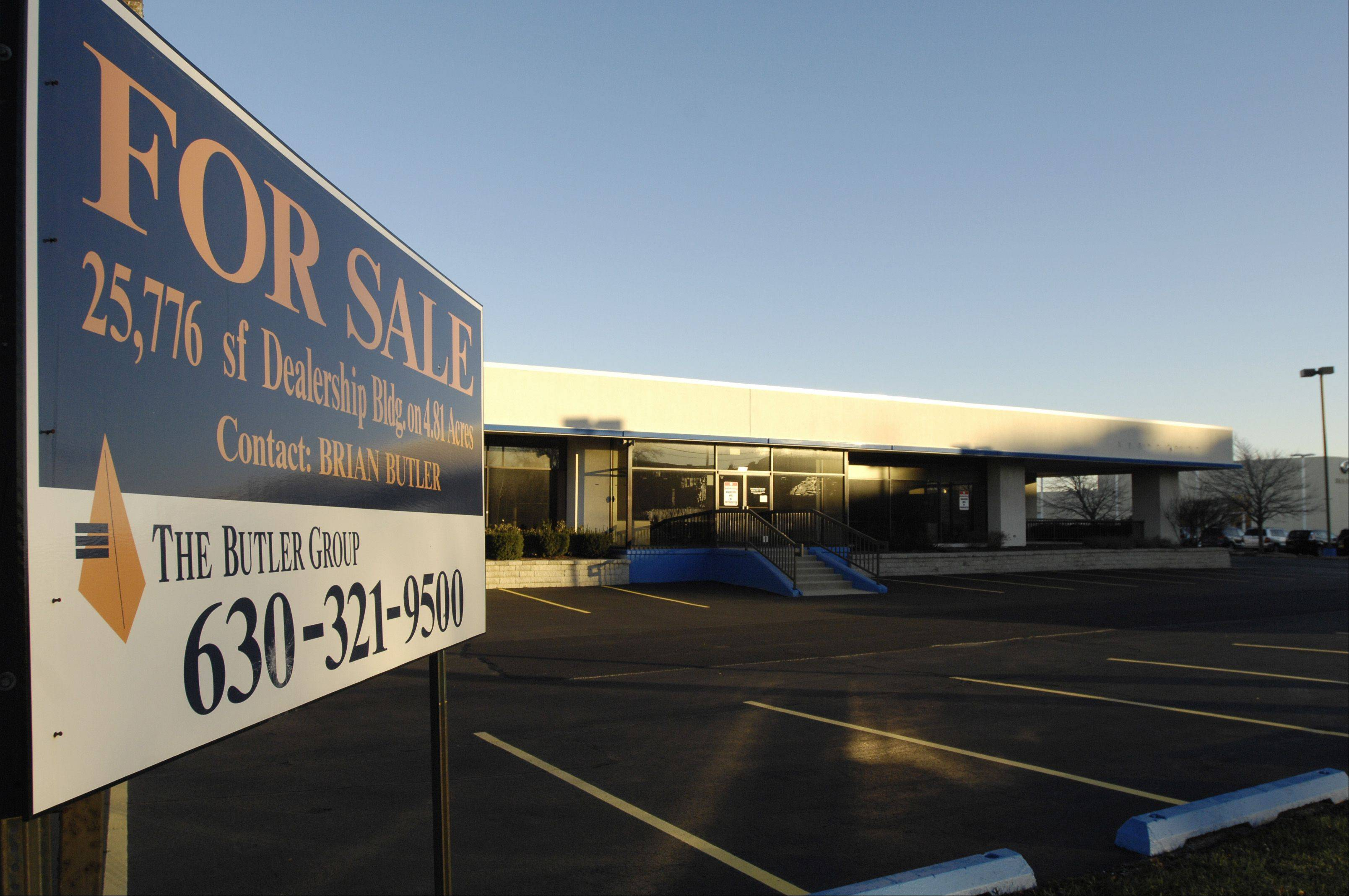 Failed businesses, like this closed car dealership along Ogden Avenue in Naperville, are one reason property taxes are shifting onto homeowners' shoulders.