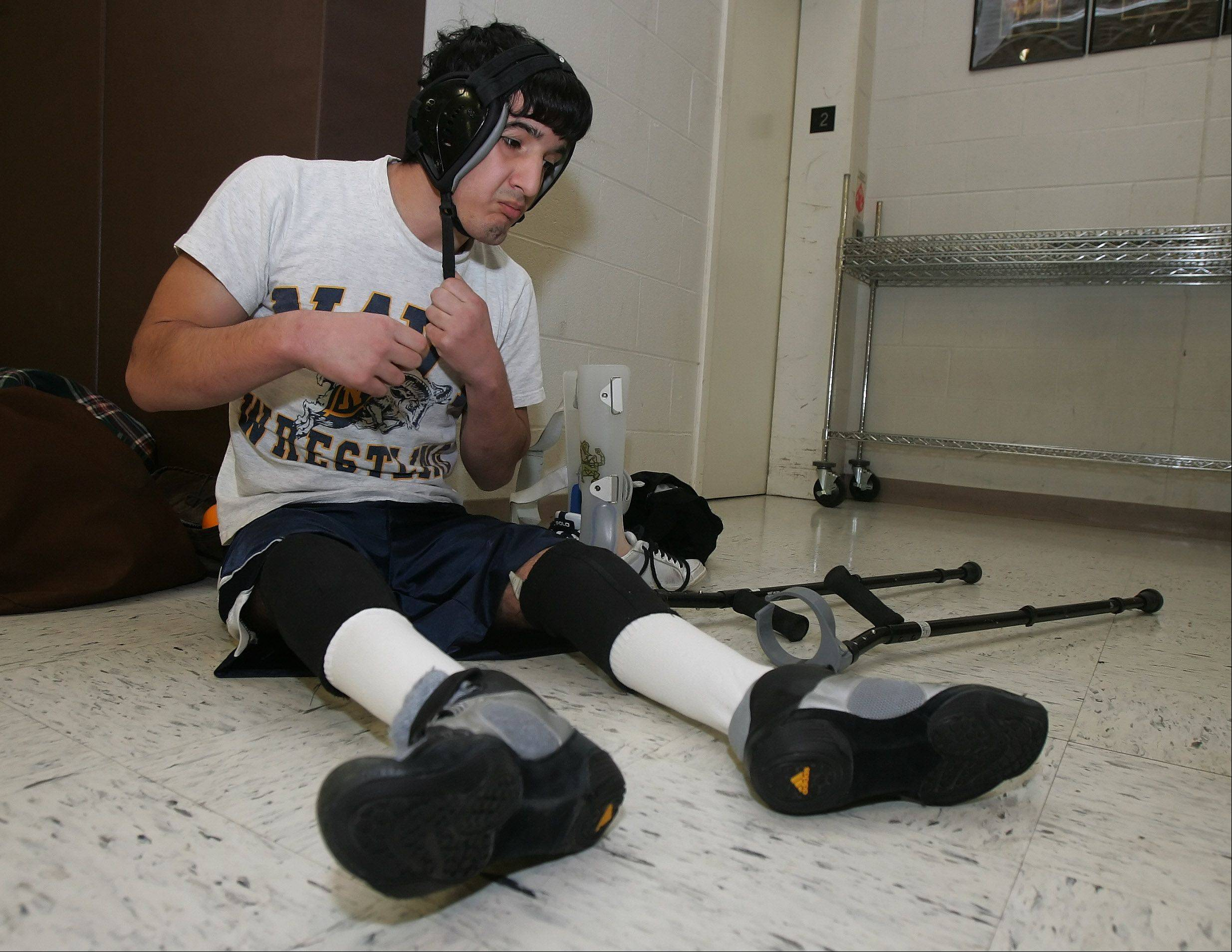 Carmel Catholic's Cristian Migliarese prepares for wresting practice. He's won twice by pin this season.