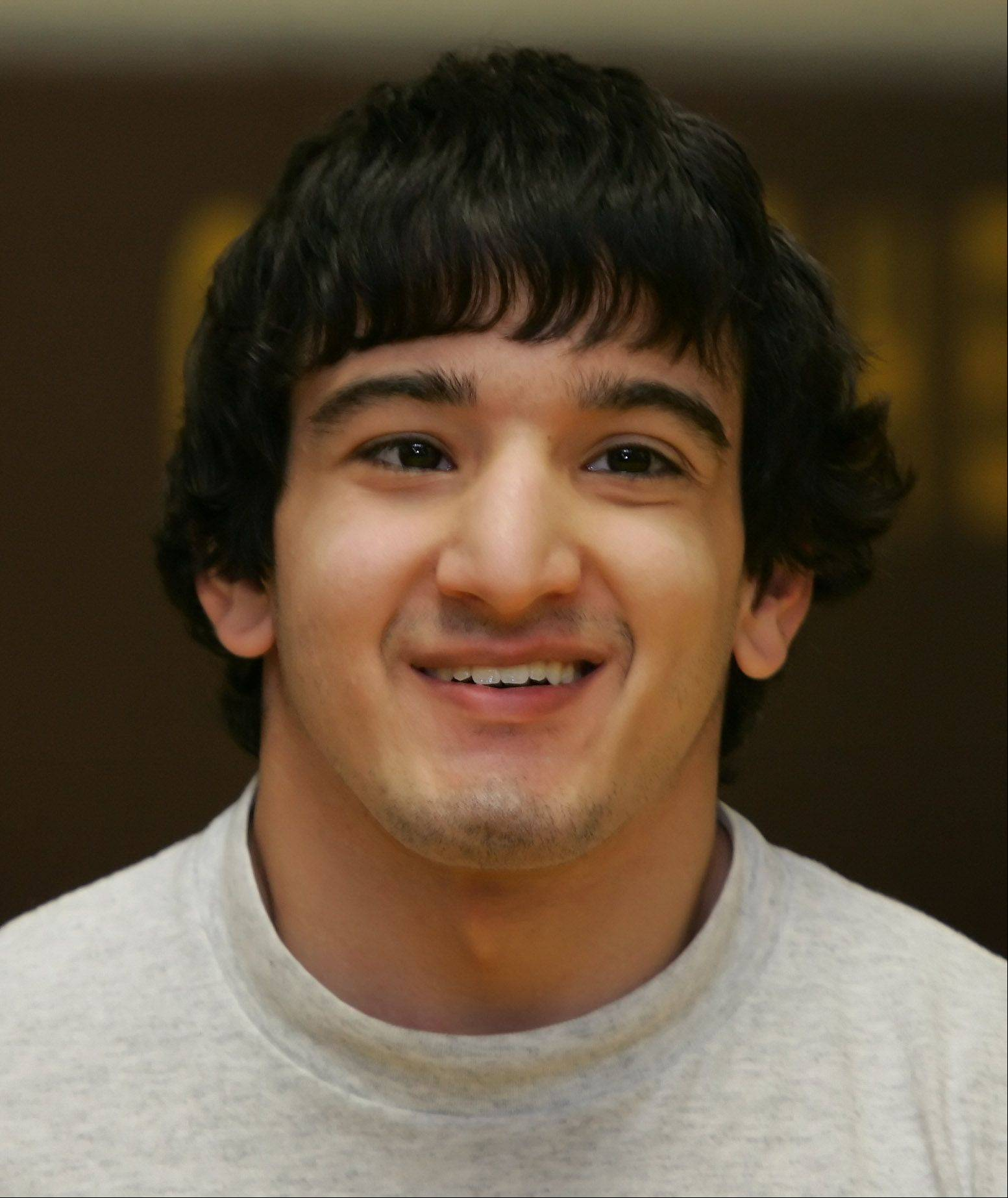 Carmel Catholic wrestler Cristian Migliarese has spina bifida but has won twice by pin so far this season.