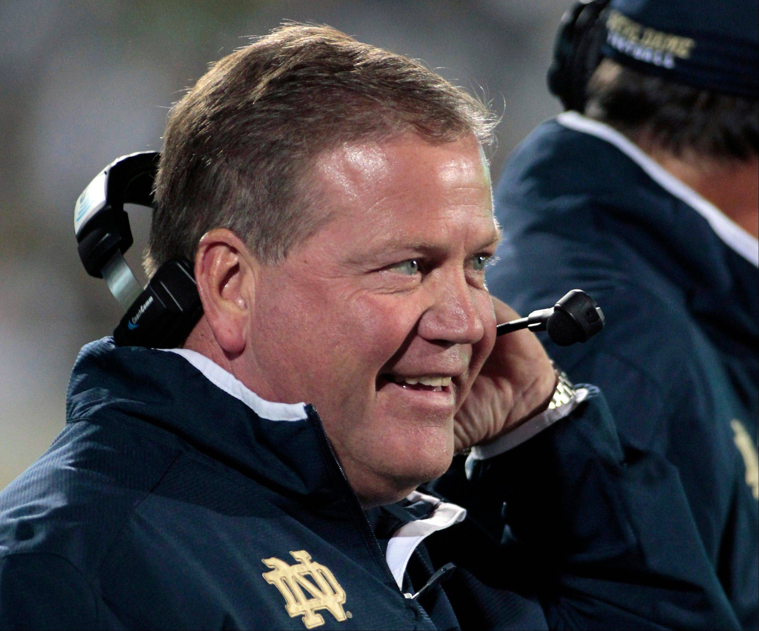 Notre Dame coach Brian Kelly, who led the Fighting Irish to the BCS championship game this season, was voted Associated Press college football coach of the year Wednesday.