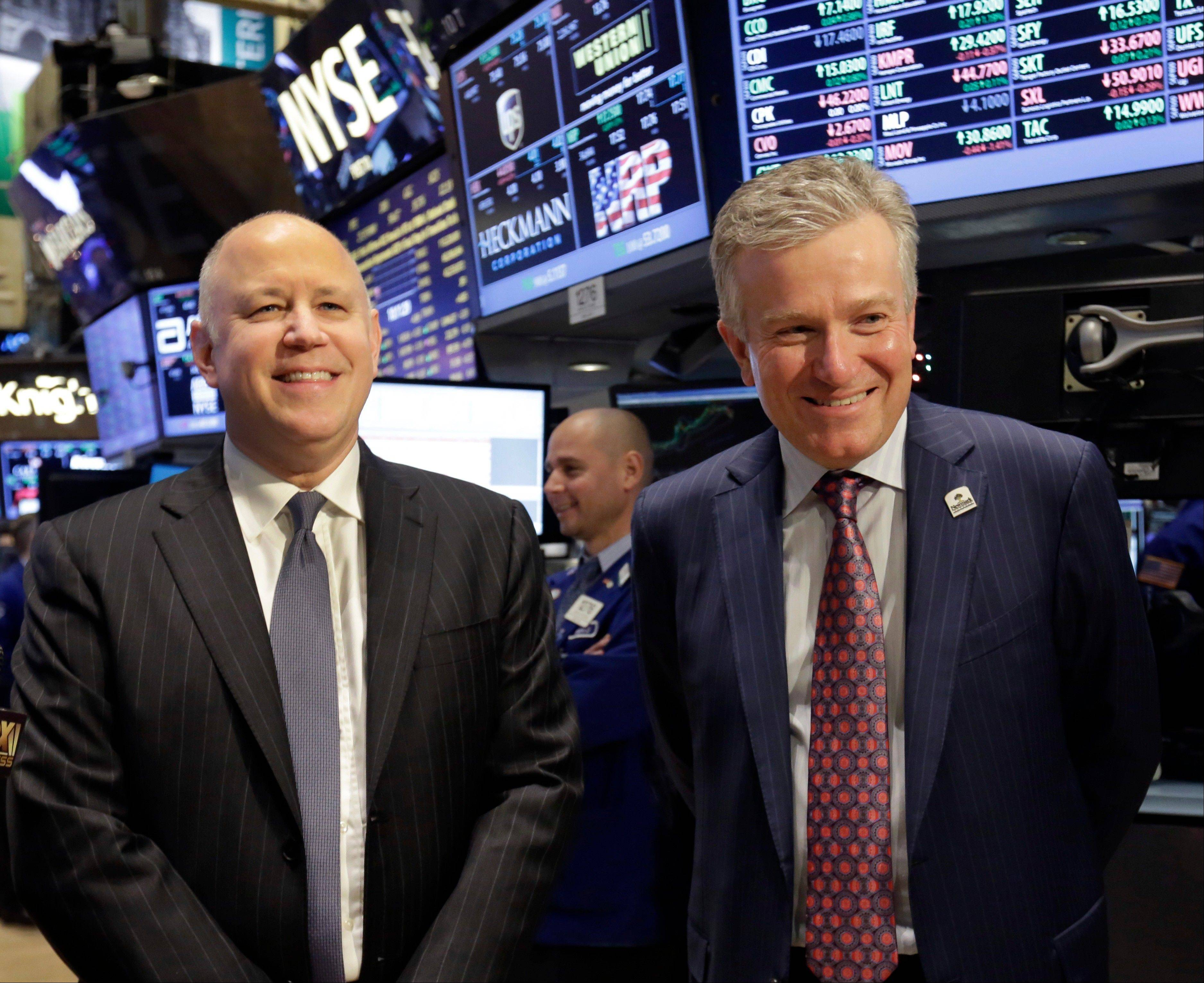 Intercontinental Exchange Inc. Chairman and CEO Jeffrey Sprecher, left, and NYSE CEO Duncan Niederauer prepare for an interview on the floor of the New York Stock Exchange Thursday. The New York Stock Exchange is being sold to a rival exchange for about $8 billion, ending more than two centuries of independence for the iconic Big Board.