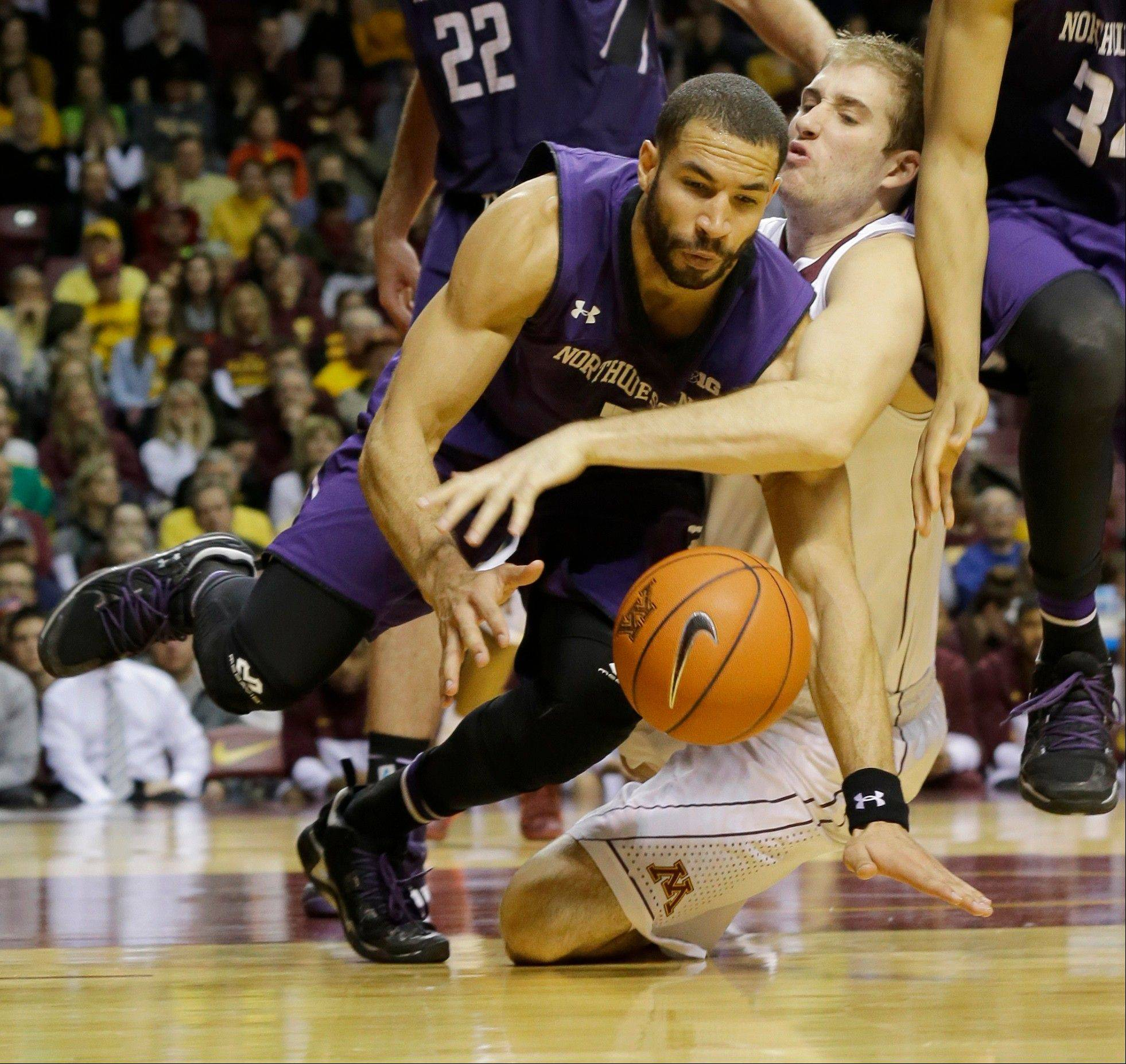 Northwestern guard Drew Crawford, left, earned Player of the Week honors in the Big Ten for leading the Wildcats to impressive road wins over Wisconsin and Minnesota last week. Crawford, a Naperville Central grad, had 30 points against the Badgers and 17 points against Minnesota.