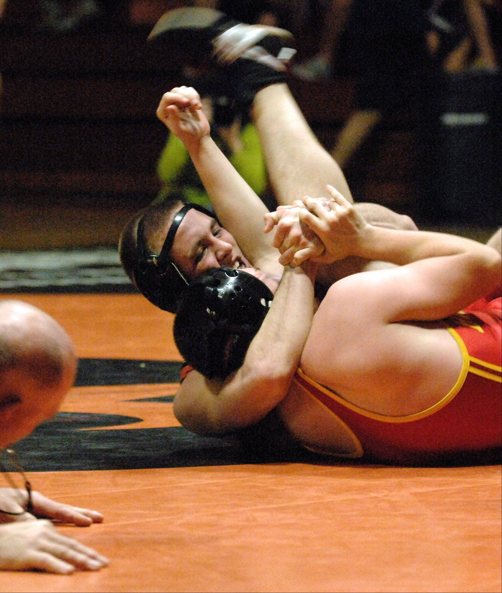 St. Charles East�s Cam Carlso defeats Batavia�s Nick Offutt at 170-pounds during Thursday�s wrestling action at St. Charles East.