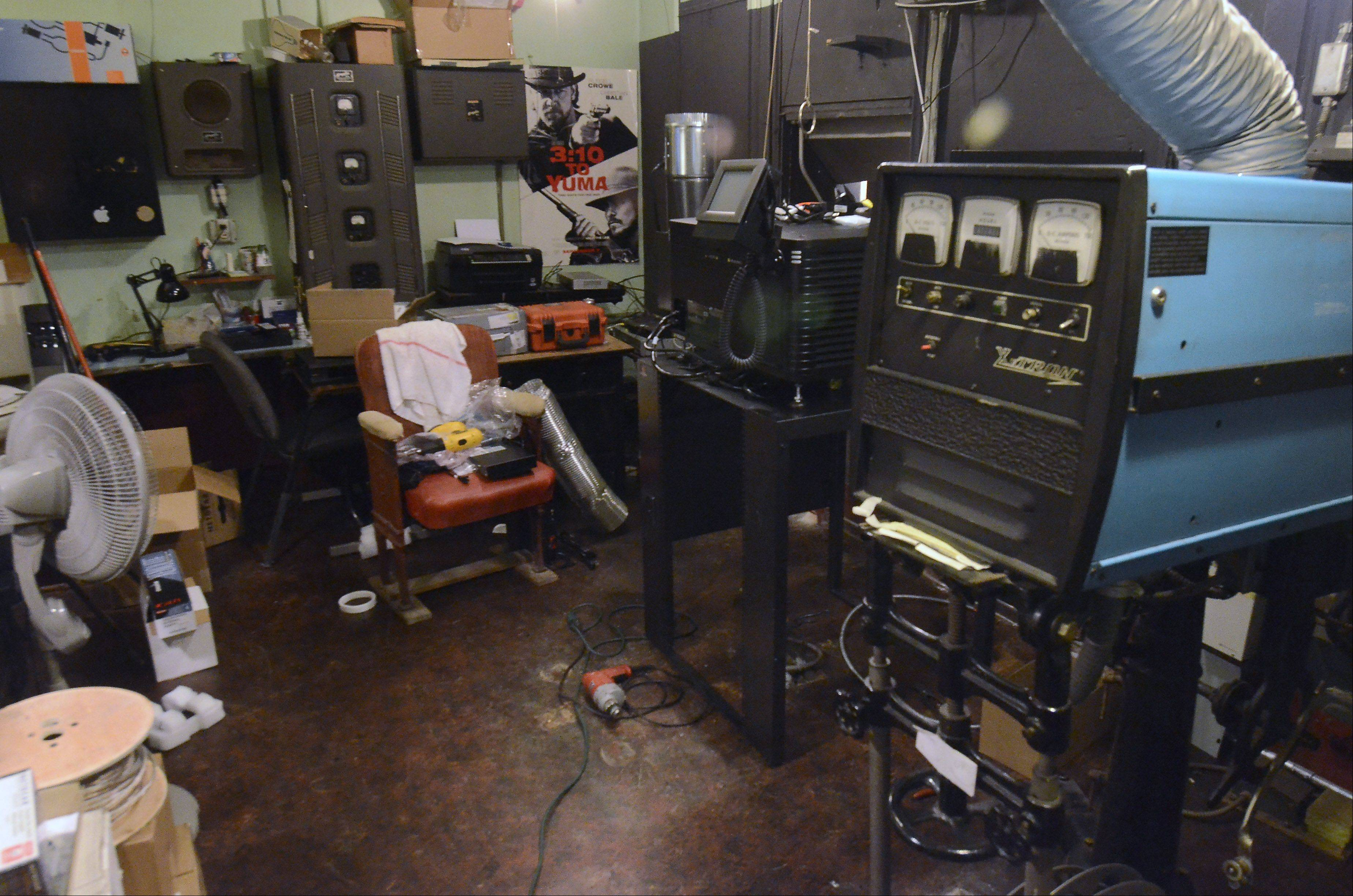 The old film projector in the projection booth at the Catlow theater in Barrington, at right, will be donated to the Portage theater in Chicago. The projector was replaced Wednesday as the theater welcomed a new digital projector purchased through patron donations.