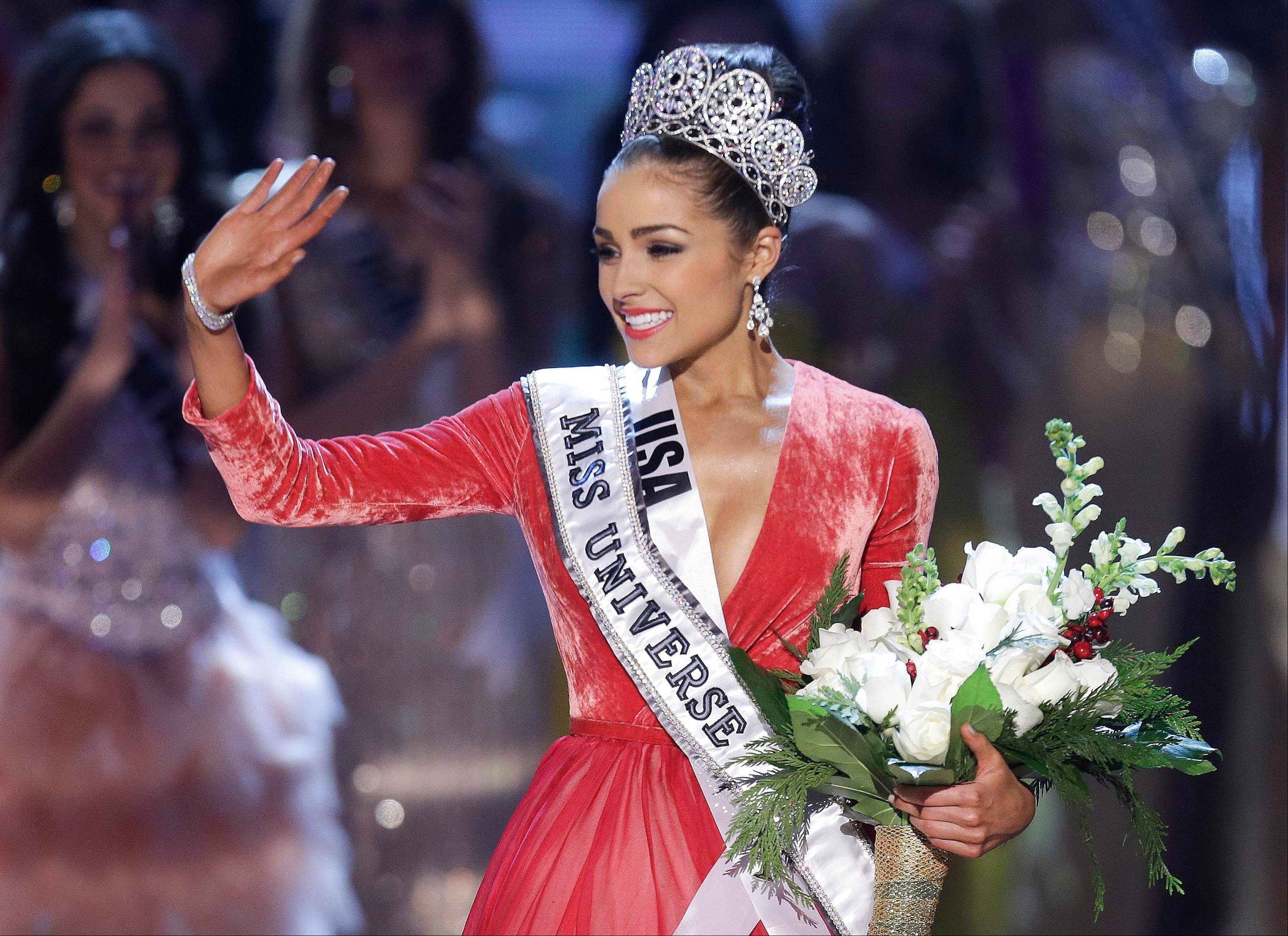 Miss USA Olivia Culpo waves to the crowd after being crowned as Miss Universe during the Miss Universe competition Wednesday in Las Vegas.