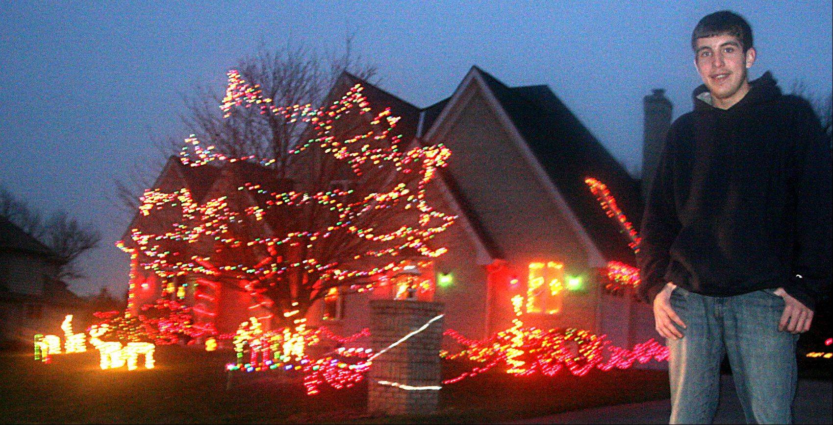 Jeffery Lawnicki, 19, did such a fine job decorating the family home in Hampshire that he won the Daily Herald's Holiday Lights Contest. See dailyherald.com to see a video of Jeffery talking about his decorations.