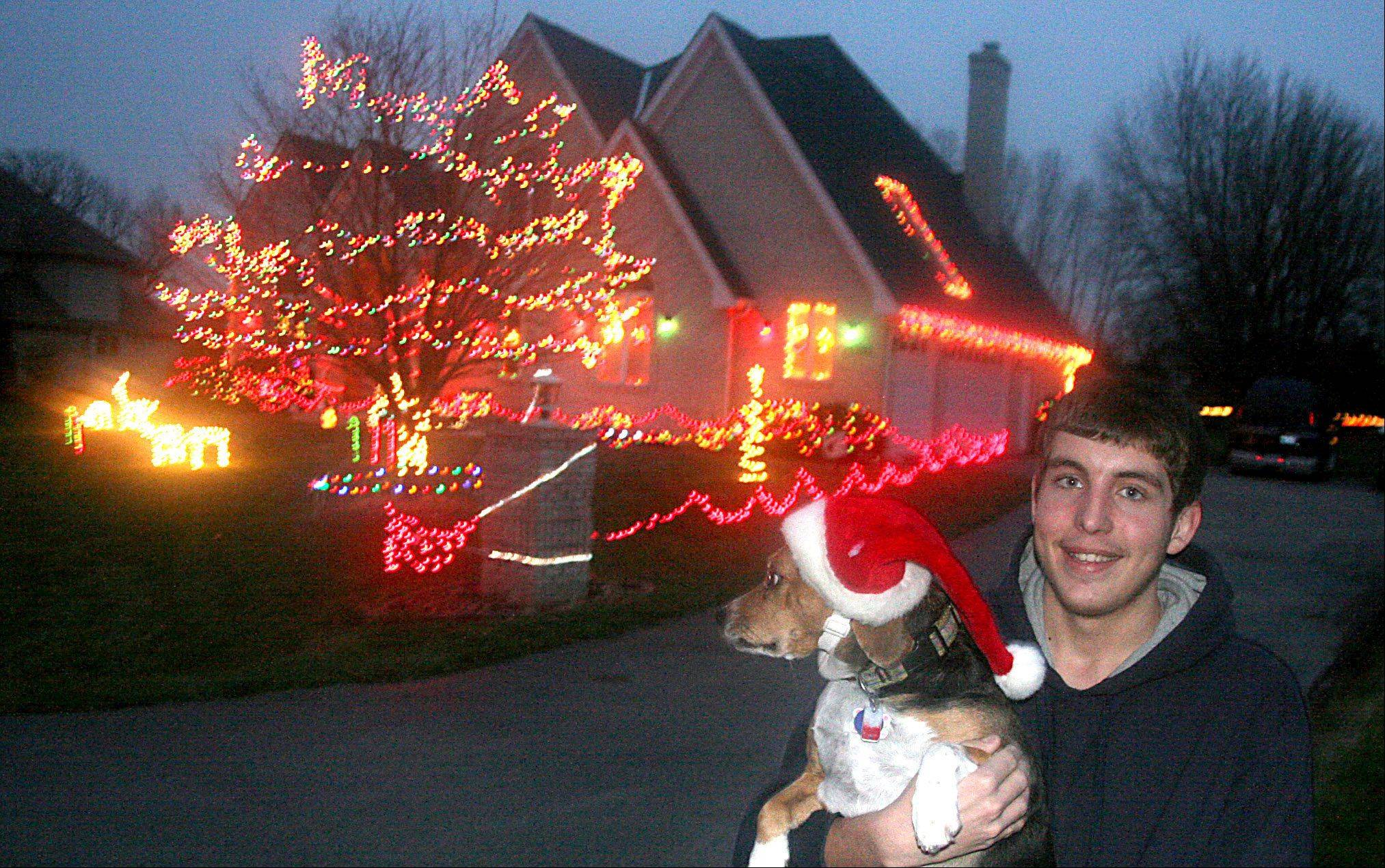 Jeffery Lawnicki, 19, decorated his family home in Hampshire, and for his efforts has won the Daily Herald's Holiday Lights Contest. See dailyherald.com to see a video of Lawnicki talking about his decorations. He is pictured with his beagle, Daisy.