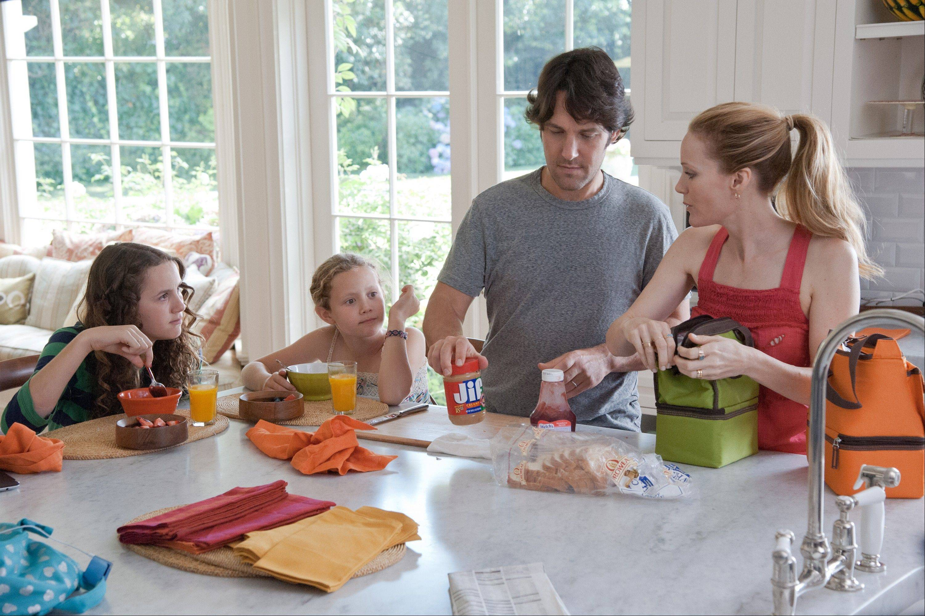 "Family life proves stressful for Sadie (Maude Apatow), left, Charlotte (Iris Apatow), Pete (Paul Rudd) and Debbie (Leslie Mann) in Judd Apatow's ""This is 40."""