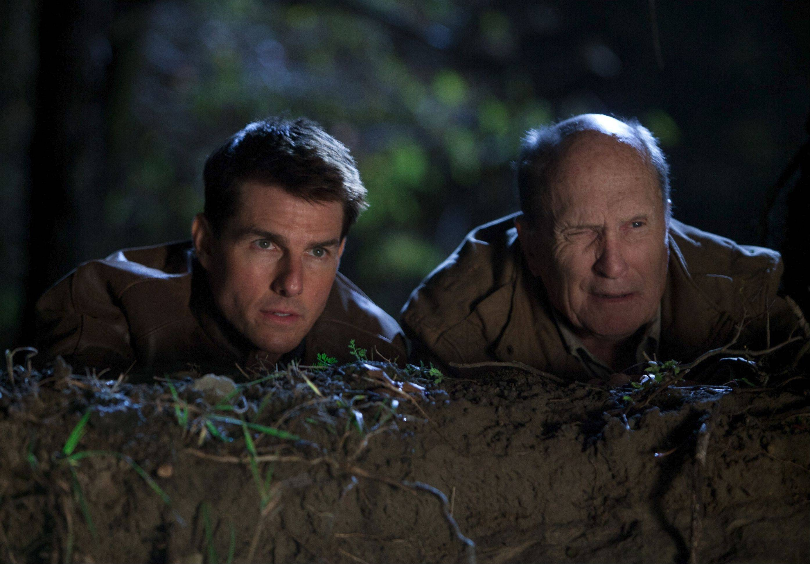 "Ex-military agent Jack Reacher (Tom Cruise) gets unlikely backup from a gun store owner (Robert Duvall) in the action film ""Jack Reacher."""