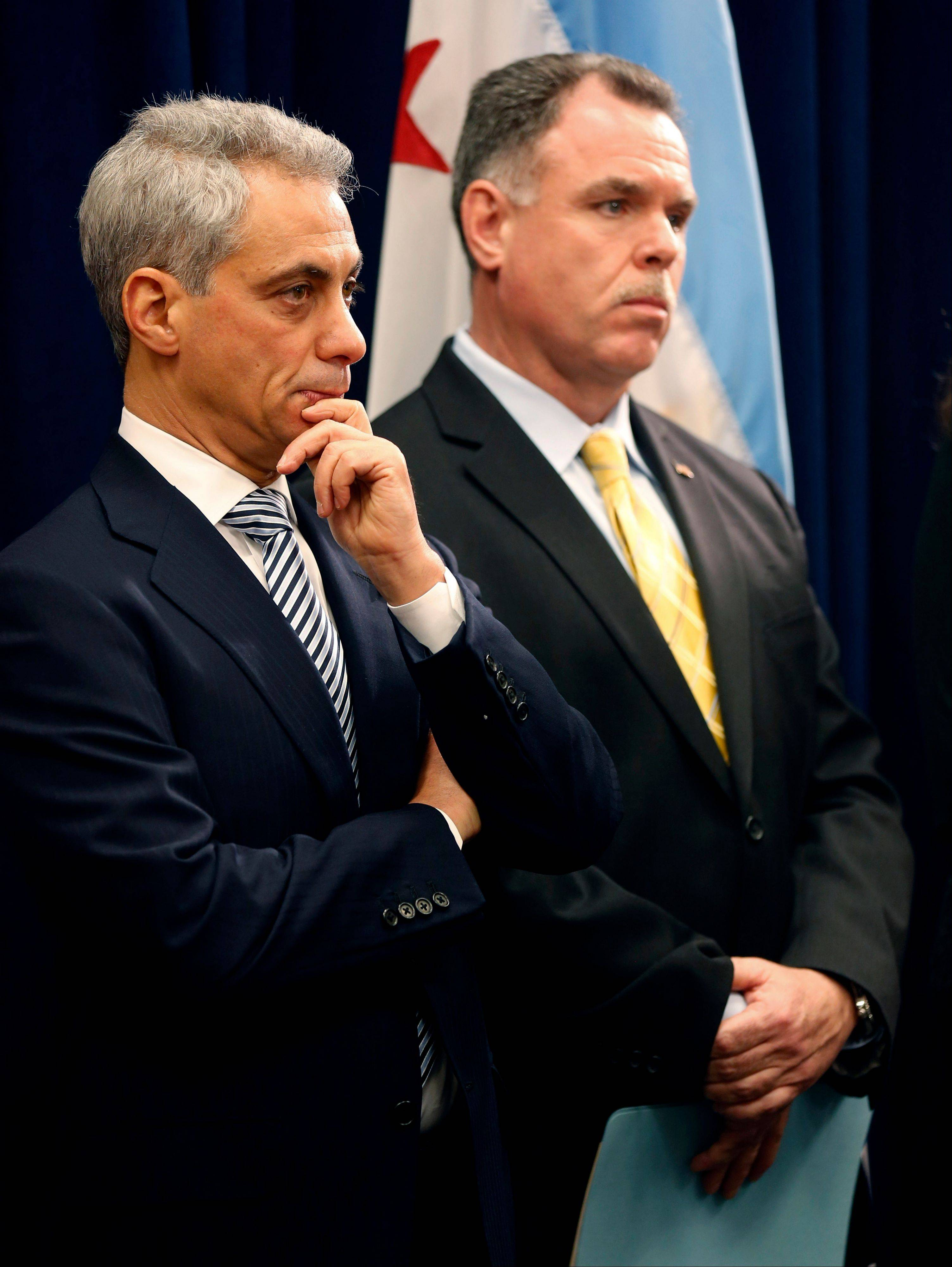 Chicago Mayor Rahm Emanuel, left, and Police Superintendent Gary McCarthy listen during a news conference pushing tougher gun laws Thursday at Chicago City Hall.