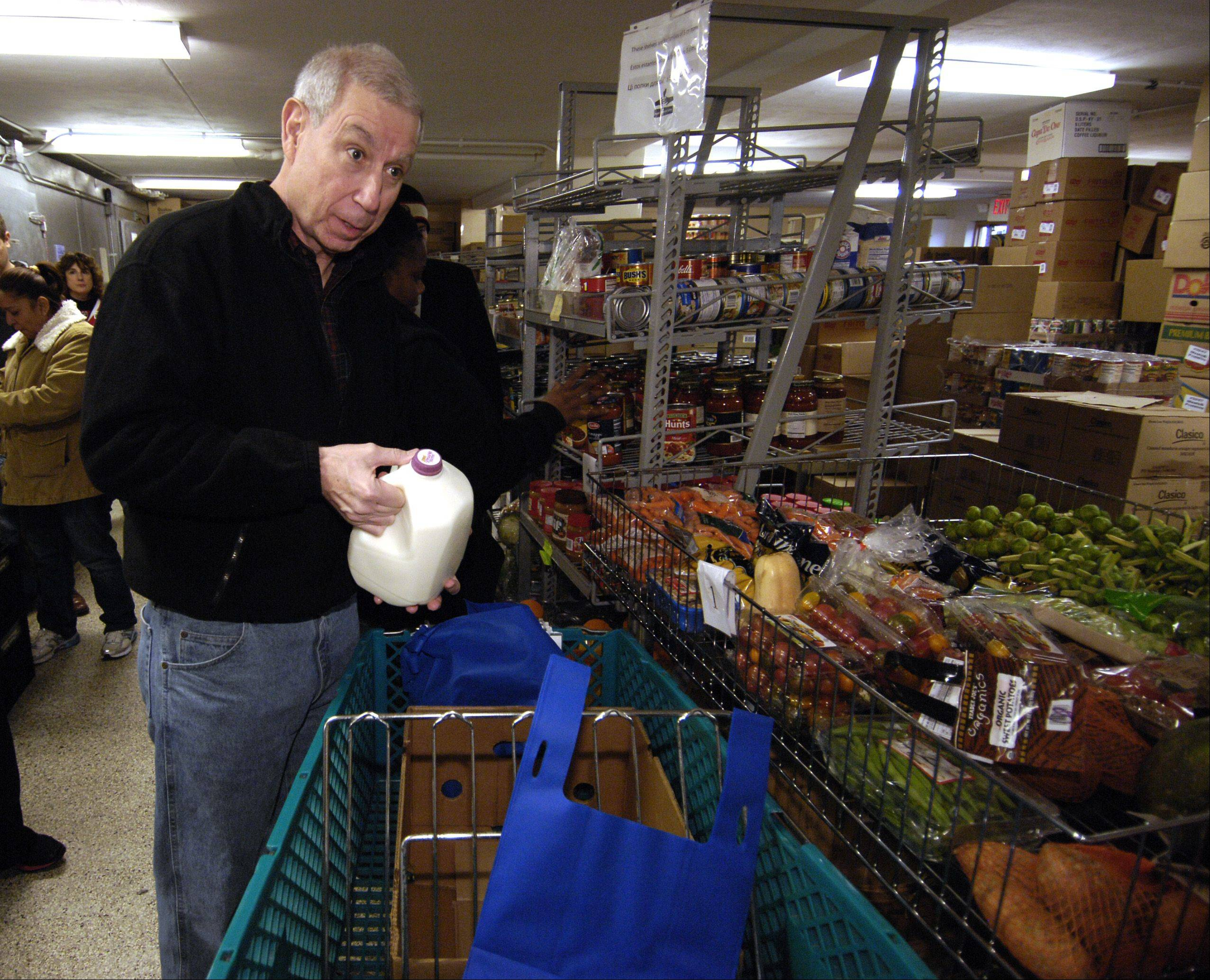Chicago Blackhawks President and CEO John McDonough helps out Thursday in the food pantry at the People's Resource Center in Wheaton.