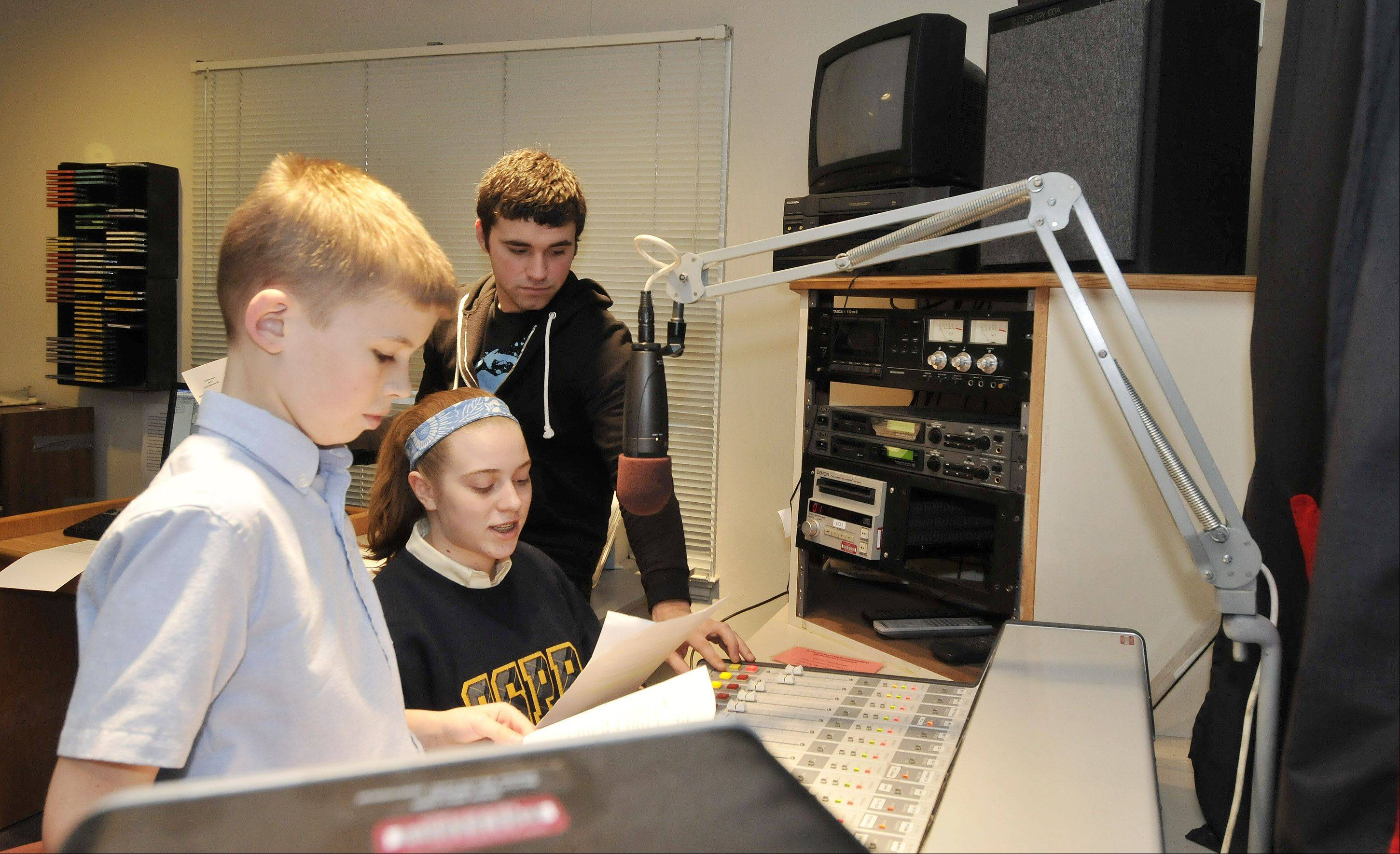 As if transported back in time, students Jack Grundman and Caroline Kubacki, with the help of North Central College producer Mike Allison, tell the Christmas story as if they were radio reporters on the scene. Ss. Peter & Paul School seventh-graders have been preparing an original radio play that will air Sunday on WONC 89.1-FM.