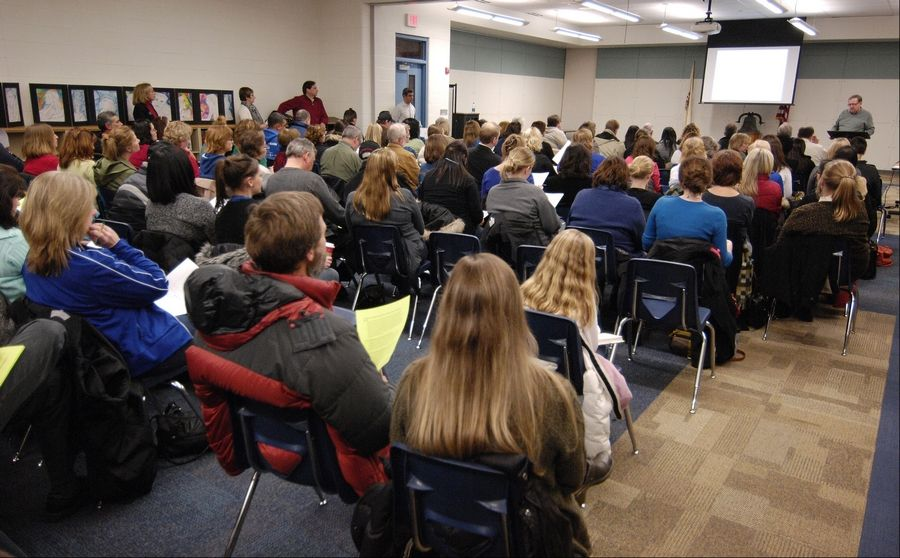 More than 100 people attended a town-hall meeting Wednesday outlining details of a contract dispute between the West Chicago Elementary District 33 school board and its teachers union.