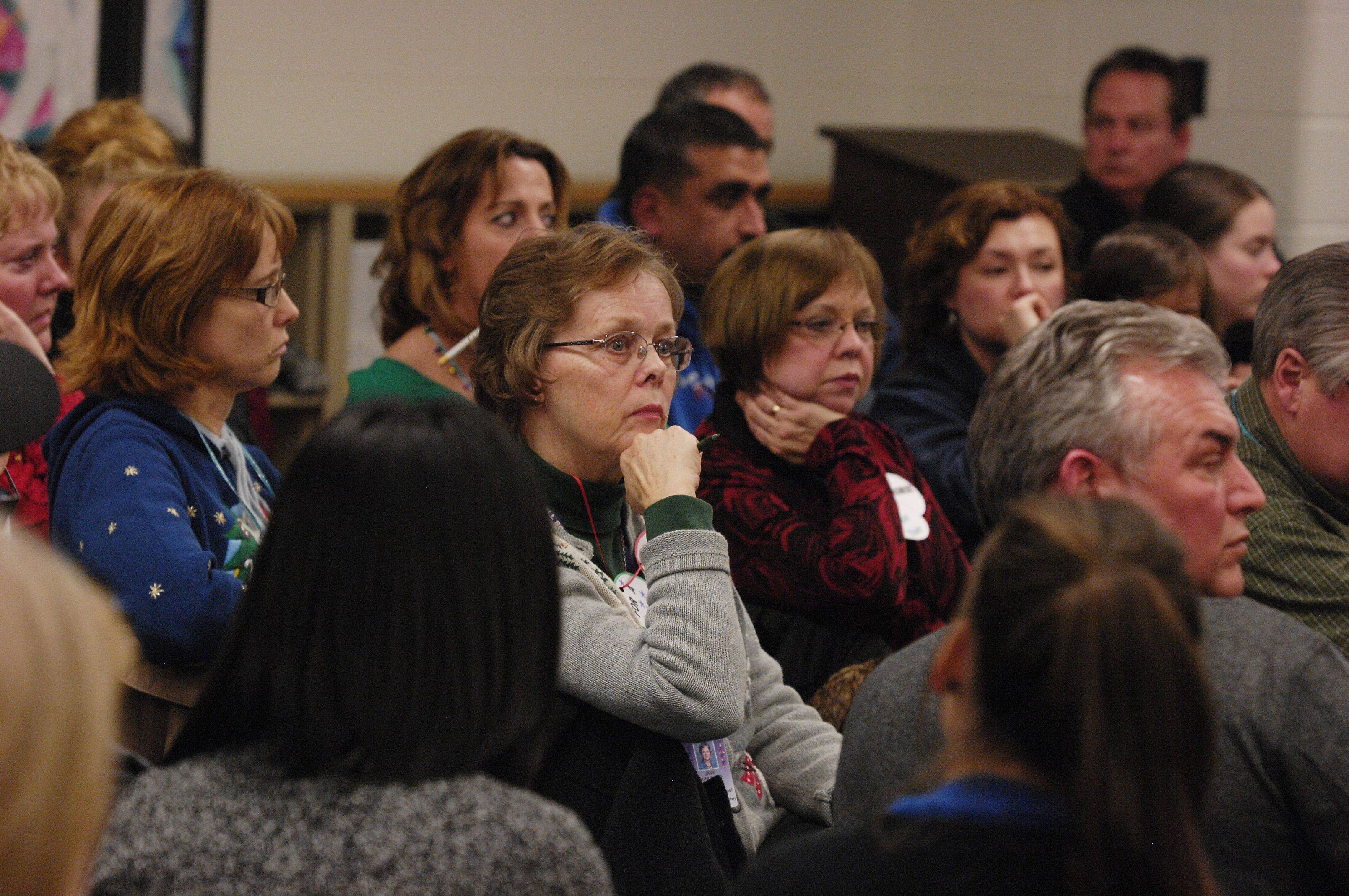 Residents, teachers and parents listen to West Chicago Elementary District 33 school board members and administrators answer questions during a town-hall meeting at West Chicago Middle School.