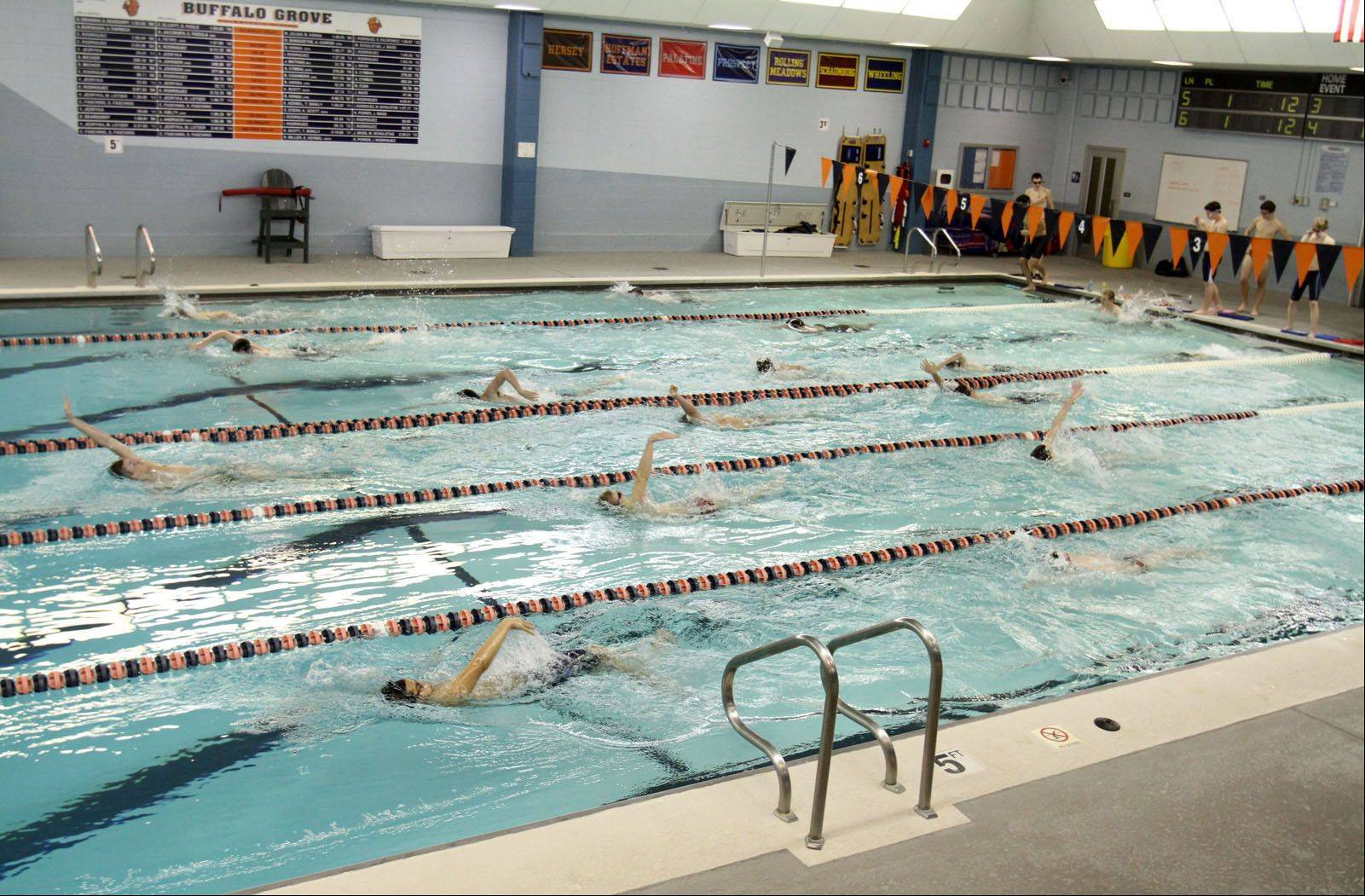 Buffalo Grove High School's boys swimming team practices at the school's pool Wednesday. Renovations this summer will create a deeper diving well, which is required by code, and expand the pool from six to eight lanes.