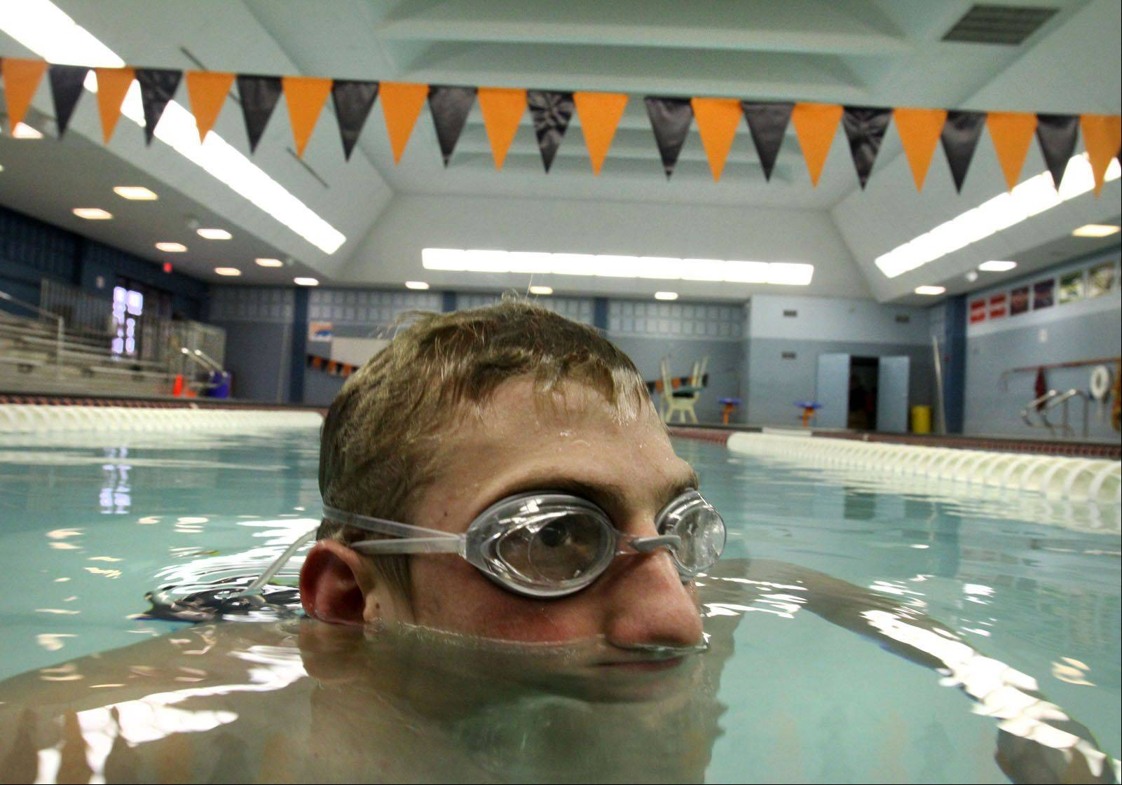 Buffalo Grove High School senior and swim team member Matt Schulstad of Arlington Heights at the school's pool. Summer pool renovations will be finished in time for the fall swimming season.