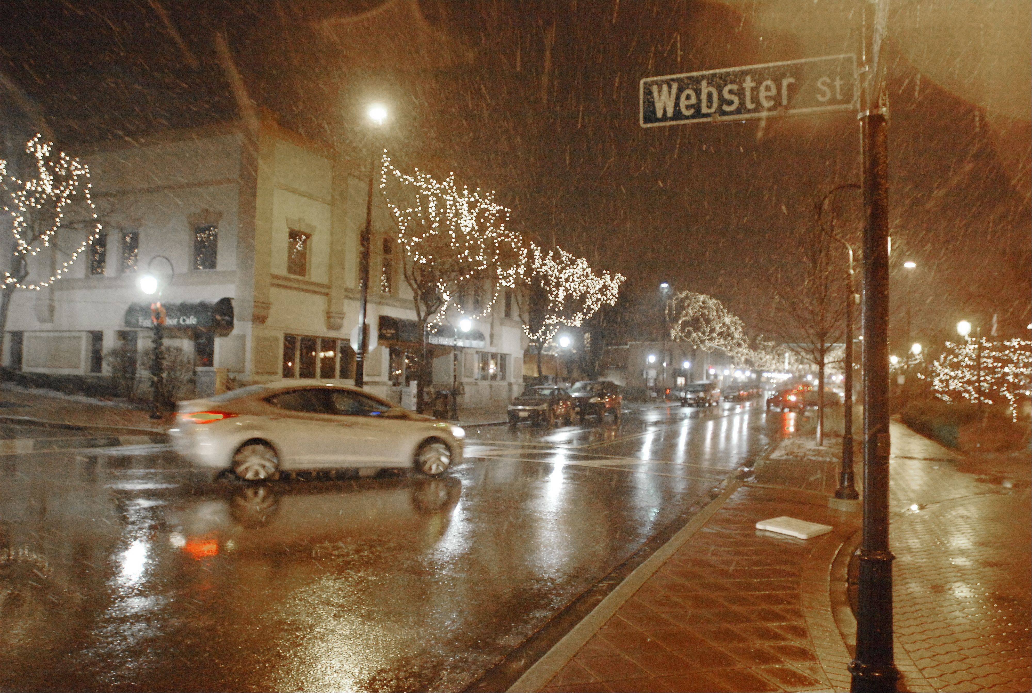 A mixture of wet snow and rain falls at the intersection of Jefferson and Webster in Naperville Thursday evening. This is the first snowfall of the season.