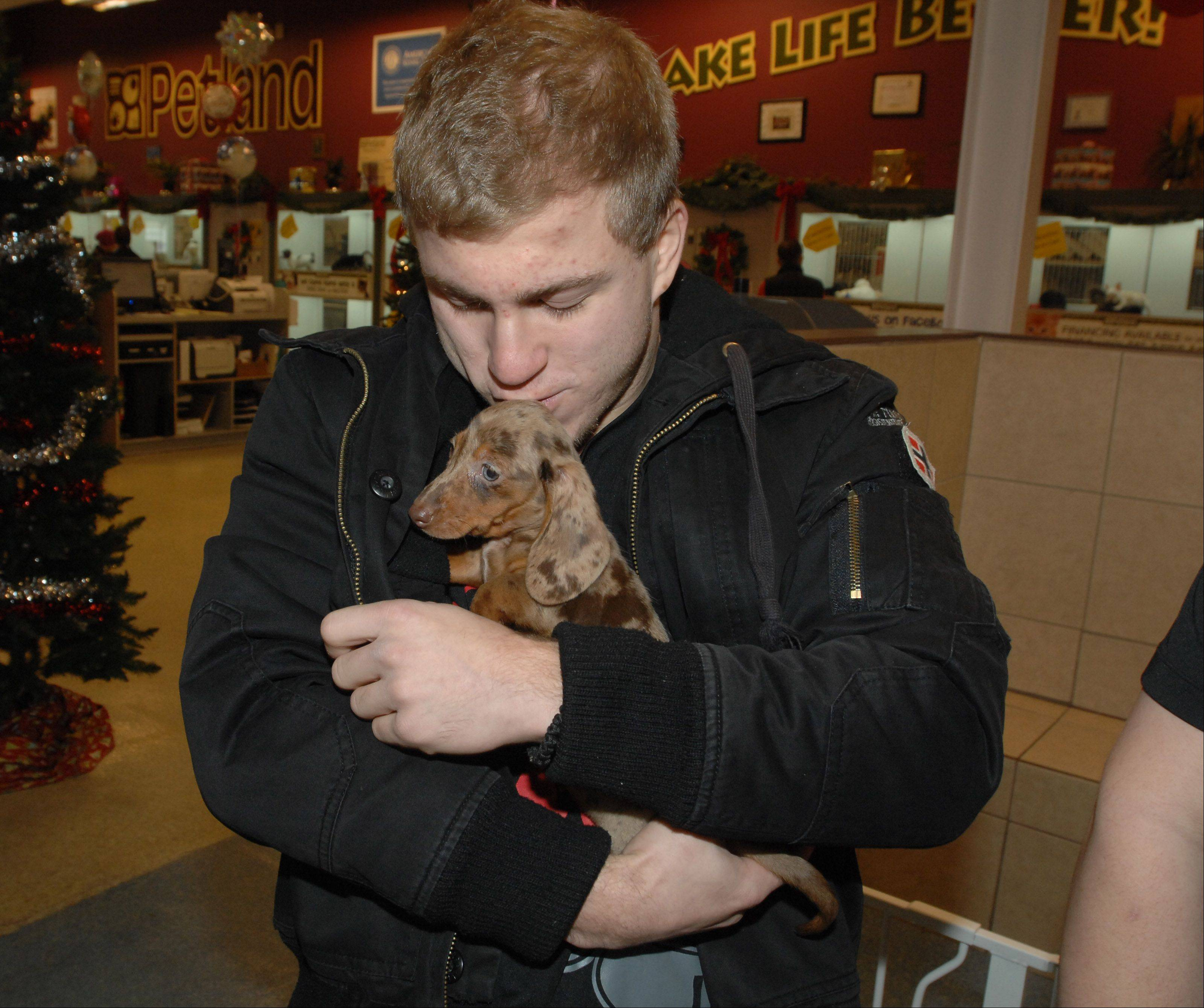 Matt Plackowski was given this Dachshund, which he later named Tootsie, to help him get through the murders of his young brother, another child and the family dog, also named Tootsie. The good folks at Petland also supplied Matt with all the dog items he will need to get started.