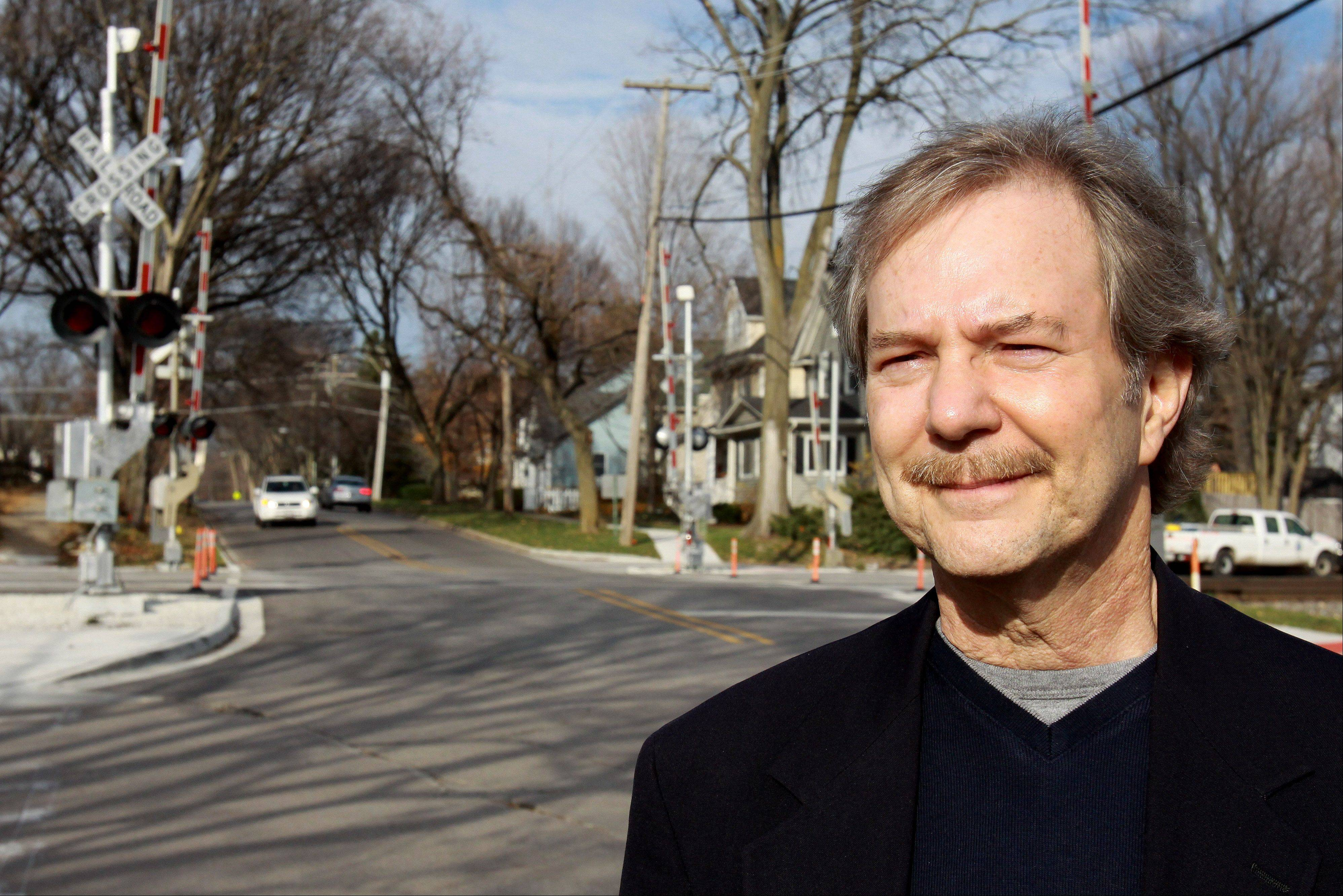 Lanny Wilson stands by a four-quad gate at Monroe Street in Hinsdale, where his daughter was killed in 1994 after a train hit her car. Wilson, a physician and chairman of the DuPage Railroad Safety Council, pushed for the safety improvement that prevents drivers from slaloming around the gates.