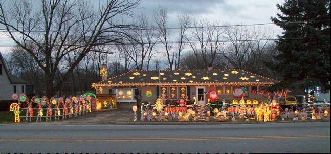 "The Sarnecke house at 493 N. Columbine Ave. (Rt. 53) in Lombard is whimsical and colorful. ""Hopefully, we make people's lives a little happier when they drive by and see out home all lit up. Have a very Merry Christmas and a healthy Happy New Year,"" Joann Sarnecke says."