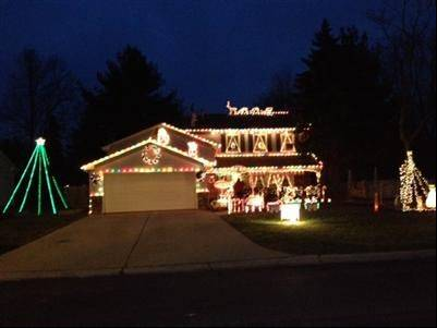 Listen to the music and watch the lights at the Evensens' display at 585 Carriage Drive in Batavia.