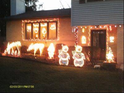 The Meyers family lights at 100 Coral Lane in Wheeling are small but to the point, Rick says.