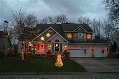 The Lindelof home is decorated and tied up with bows at 380 Crestwood Road in Wood Dale.