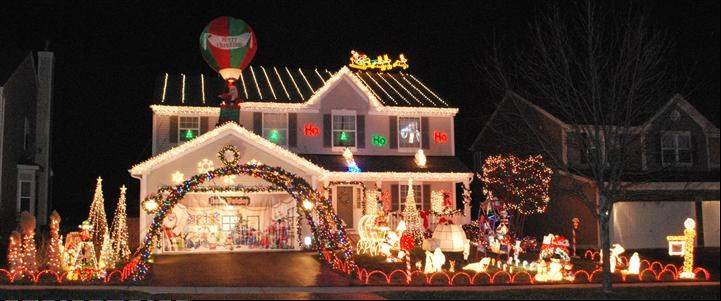 "Herzog's Winter Wonderland features three 30-foot lighted arches spanning the driveway leading to Santa's workshop at 23 N. Durham Lane in Round Lake. ""Our animated Santa can be seen in the upper window stopping by for milk and cookies and leaving presents for all the good boys and girls in the house,"" says Tim Herzog. ""We have a front yard full of playful animated animals, a working Ferris wheel, and Santa in his sleigh waving from the roof. Our biggest joy is watching the cars stop by to check out the display."" The Herzog display came in fourth in our contest."